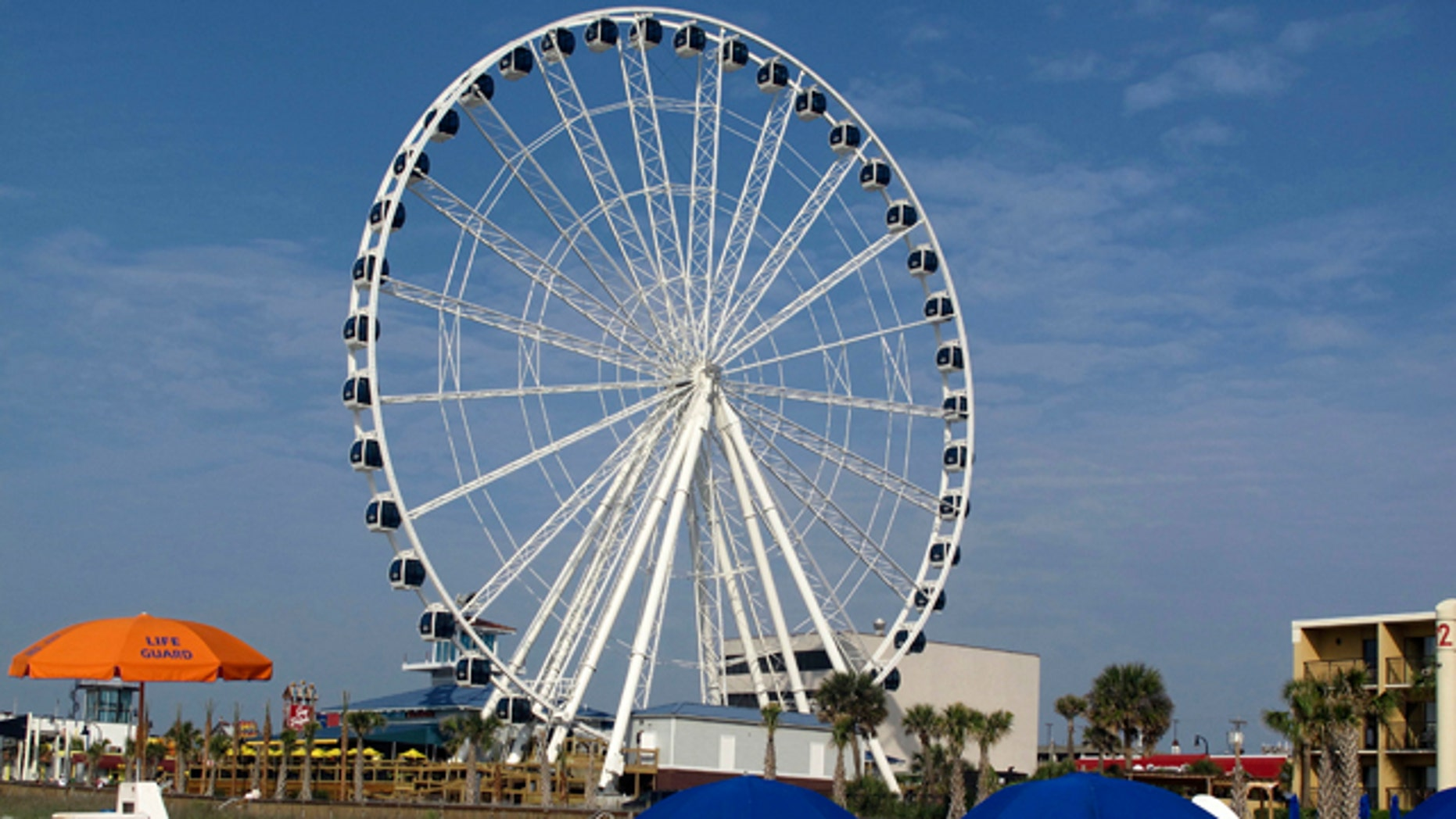 The 200-foot-tall SkyWheel is seen from the shore in Myrtle Beach, S.C., shortly before opening on Friday, May 20, 2011. The SkyWheel, the tallest Ferris wheel in the eastern United States with a million LED lights and 42 air-conditioned gondolas, started spinning Friday in this beach resort on the South Carolina coast.     (AP Photo/Bruce Smith)