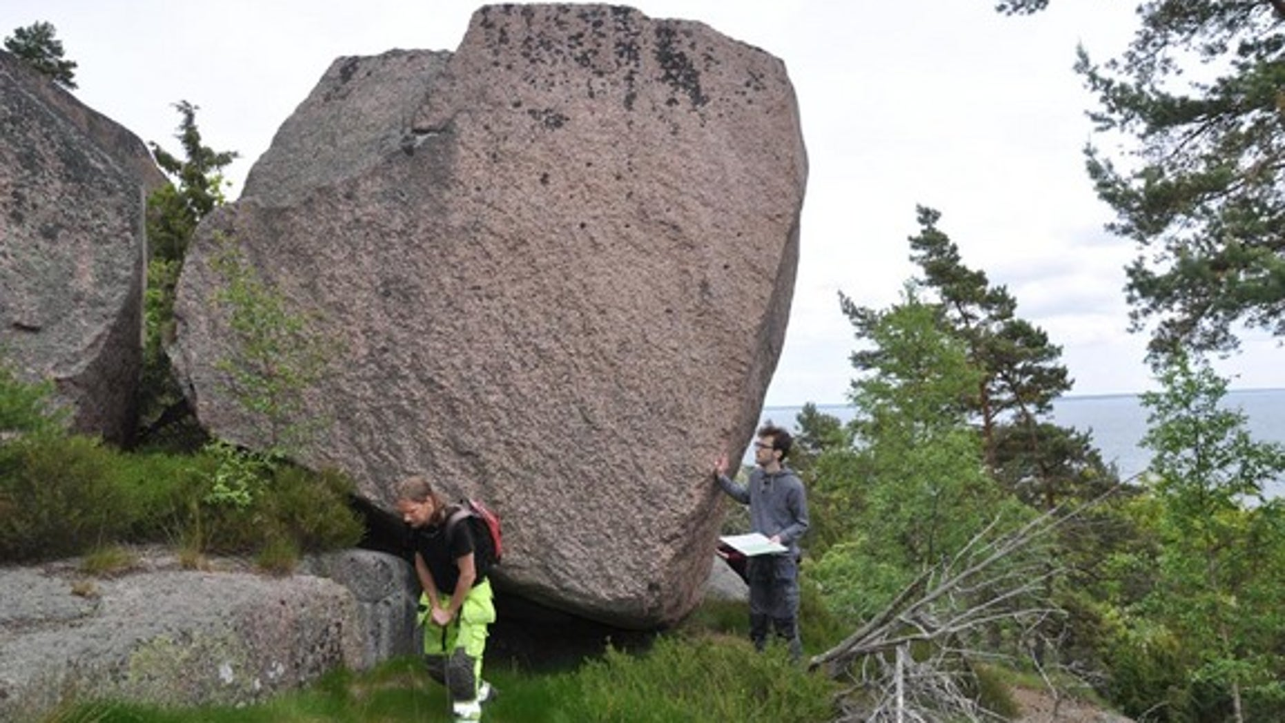 Archaeologists work on the island off Sweden where they discovered evidence of Stone Age rituals. The island has long been linked with tales of witchcraft, supernatural powers and curses.