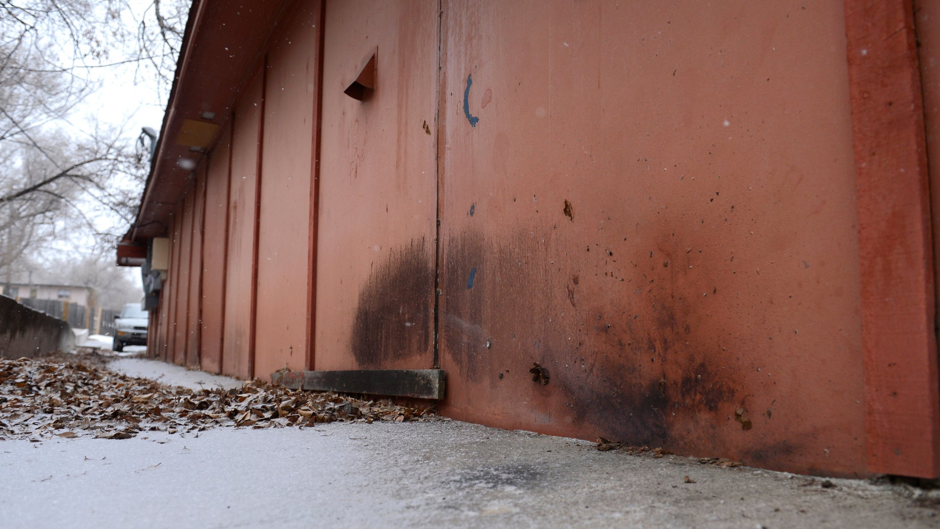 Jan. 6, 2015:  Char marks from a device detonated Tuesday along the northeast corner of a building occupied by a barber shop near the Colorado Springs chapter of the NAACP in Colorado Springs, Colo.