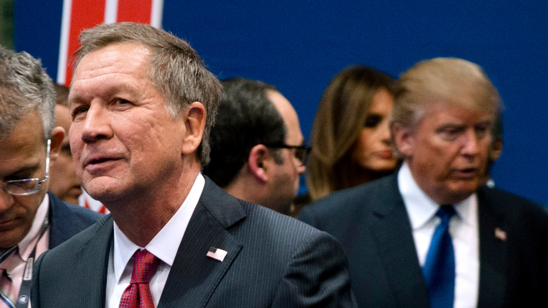 Feb. 6, 2016: Ohio Gov. John Kasich, left, and Donald Trump, right, speak to reporters after a Republican presidential primary debate hosted by ABC News at Saint Anselm College in Manchester, N.H.
