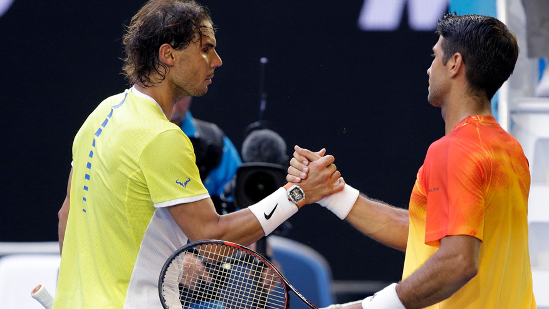 Jan. 19, 2016: Rafael Nadal, left, of Spain congratulates compatriot Fernando Verdasco after their first round match at the Australian Open tennis championships in Melbourne, Australia.