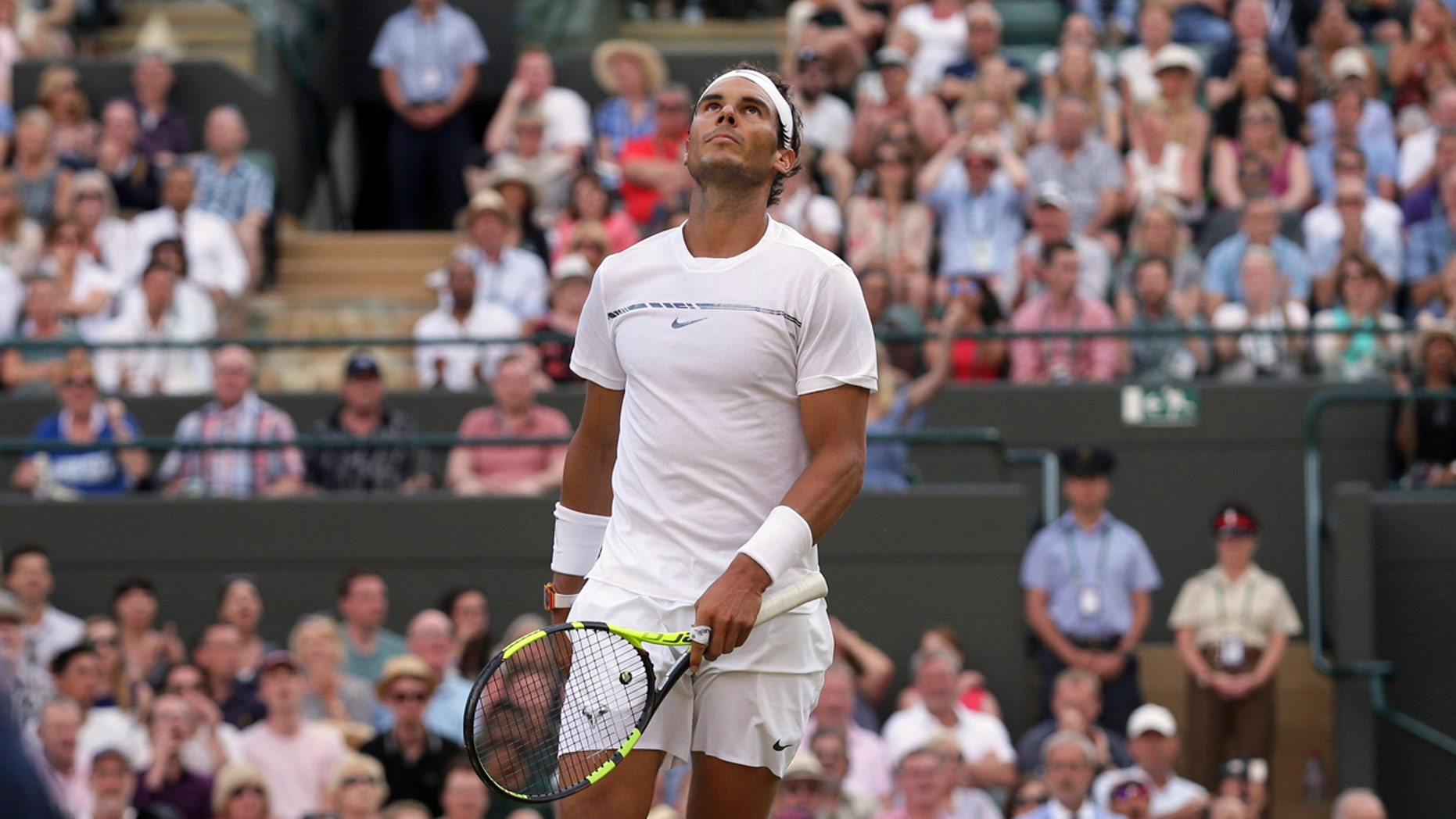 Rafael Nadal looks up during his Round of 16 match against Gilles Muller at Wimbledon Monday