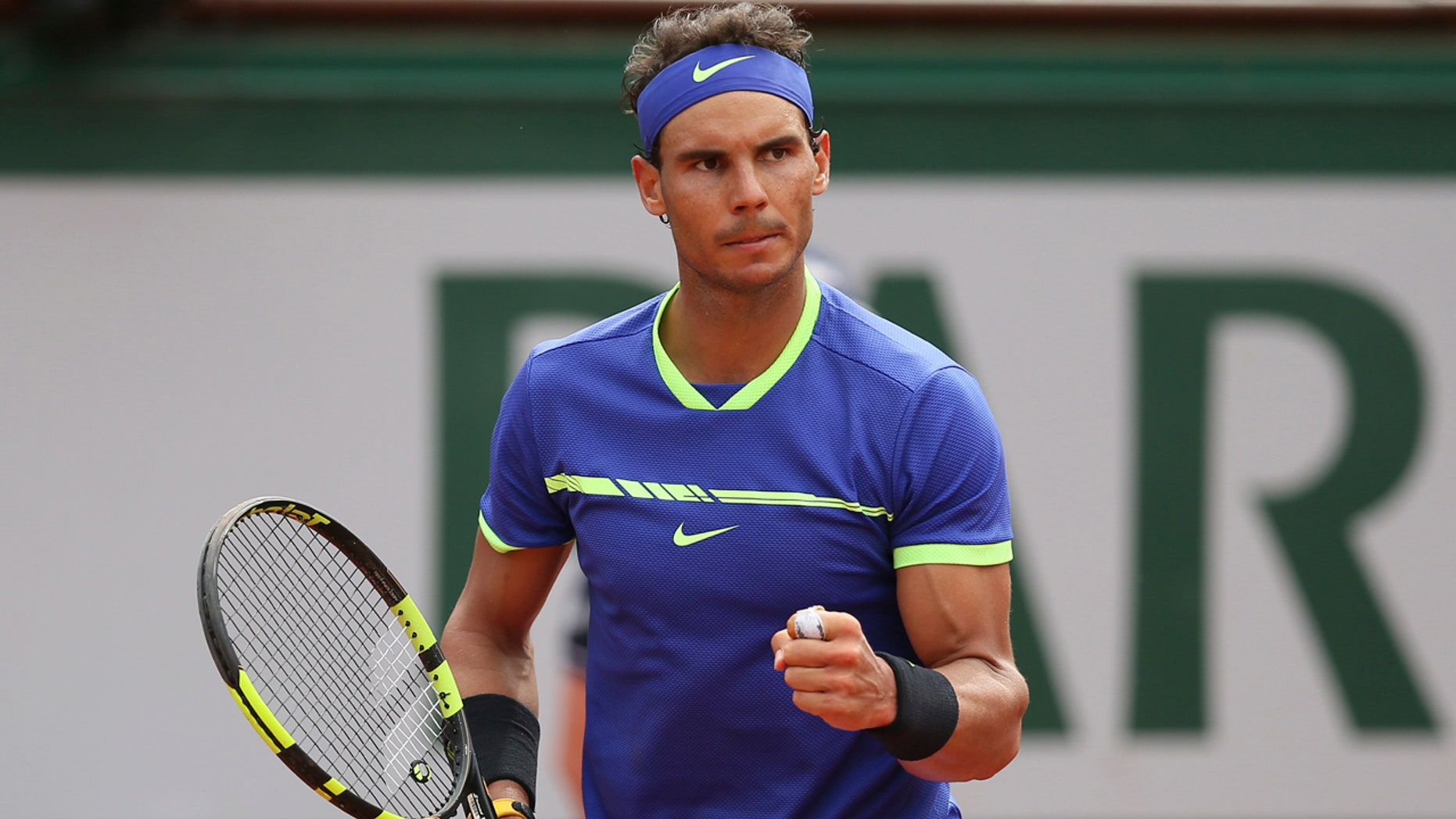 Spain's Rafael Nadal clenches his fist as he plays Switzerland's Stan Wawrinka during their final match of the French Open tennis tournament at the Roland Garros stadium, Sunday, June 11, 2017 in Paris.