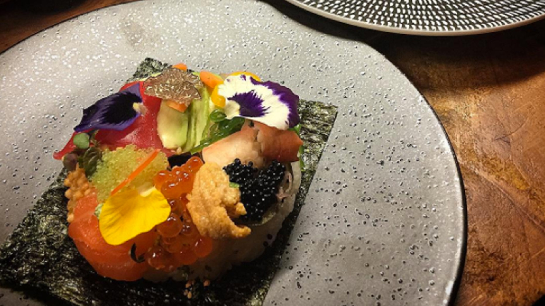The sushi doughnut is a ring-shaped dish of fish, vegetables and more.
