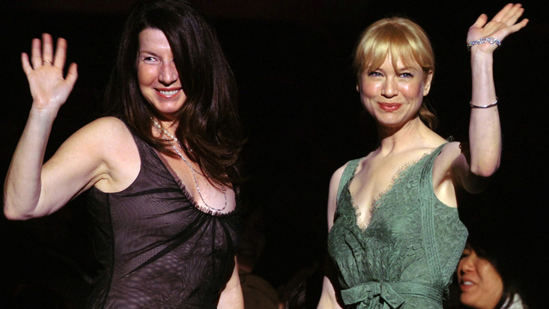 """Actress Rene Zellweger, right, and publicist Nanci Ryder wave after they are acknowledged by the audience at the start of """"What A Pair! 3,"""" a concert of songs from Broadway musicals performed by duets of famous women, to benefit the Friends of the Breast Program at the University of California in Los Angles (UCLA) April 8, 2005."""