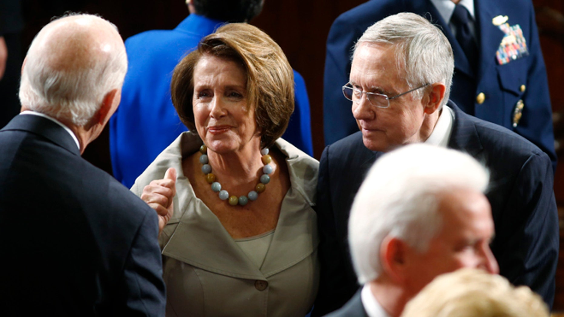 In this Sept. 18, 2014 photo, House Minority Leader Nancy Pelosi, D-Calif., and U.S. Senate Majority Leader Harry Reid, D-Nev., shown entering the House chamber on Capitol Hill in Washington.