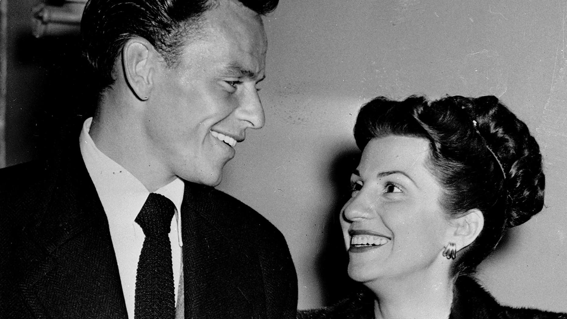 In this Oct. 23, 1946 file photo, singer Frank Sinatra and his wife Nancy smile broadly as they leave a Hollywood night club following a surprise meeting.