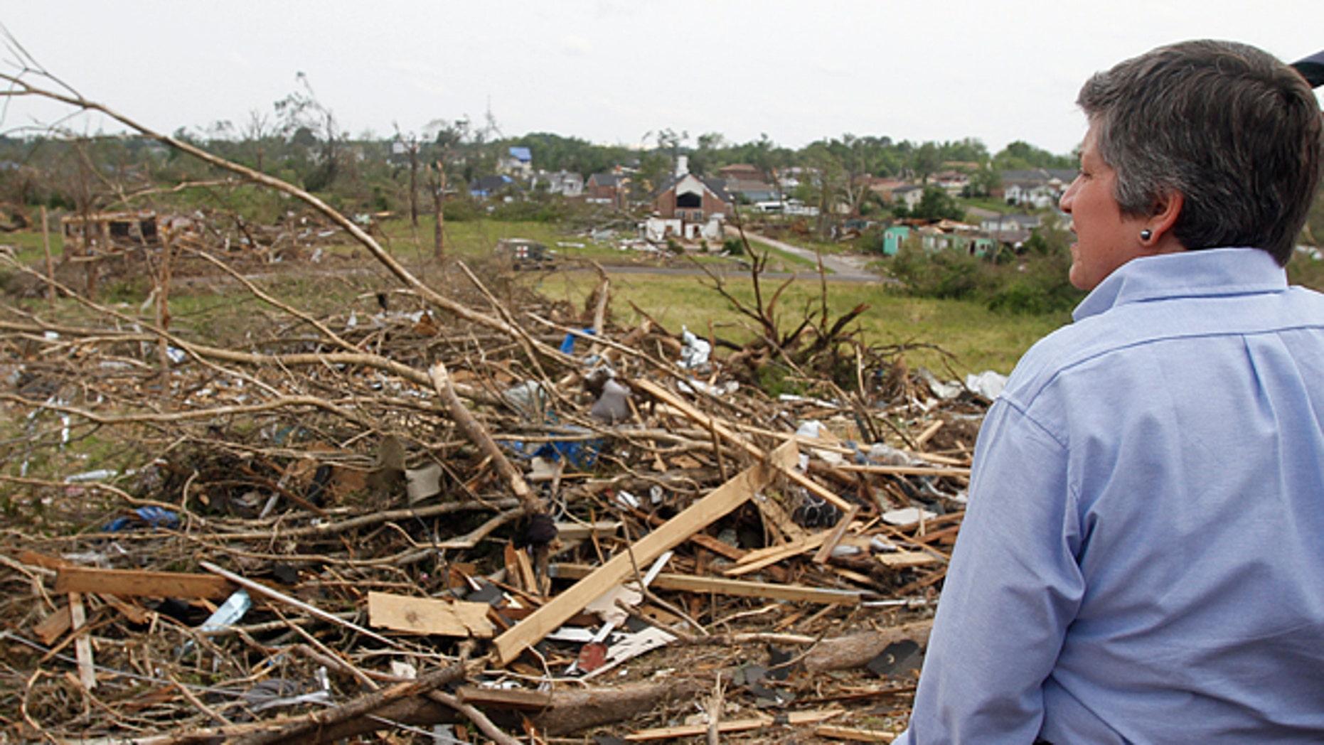 May 1: Homeland Security Secretary Janet Napolitano looks over the destruction where a tornado ripped Pratt City