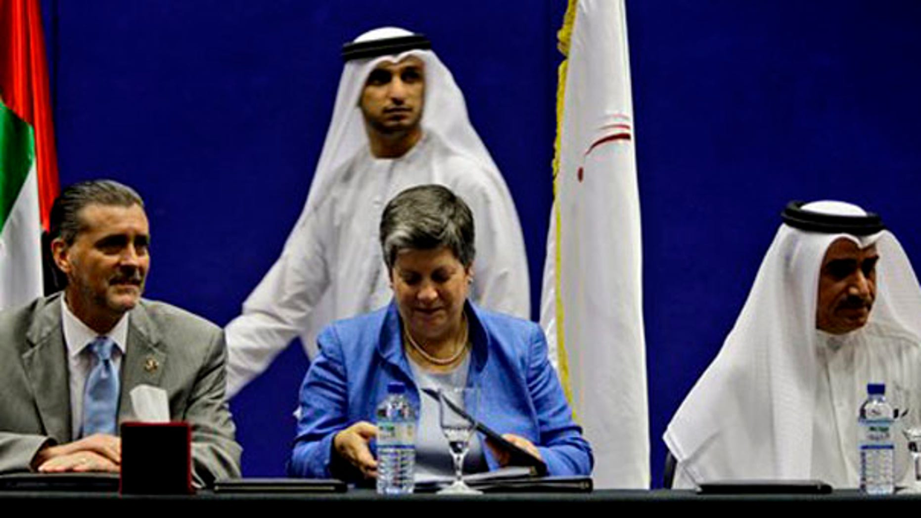 Secretary of Homeland Security Janet Napolitano, center, prepares her papers before giving a speech at a conference at the Zayed University in Abu Dhabi, United Arab Emirates, Nov. 8. (AP Photo)