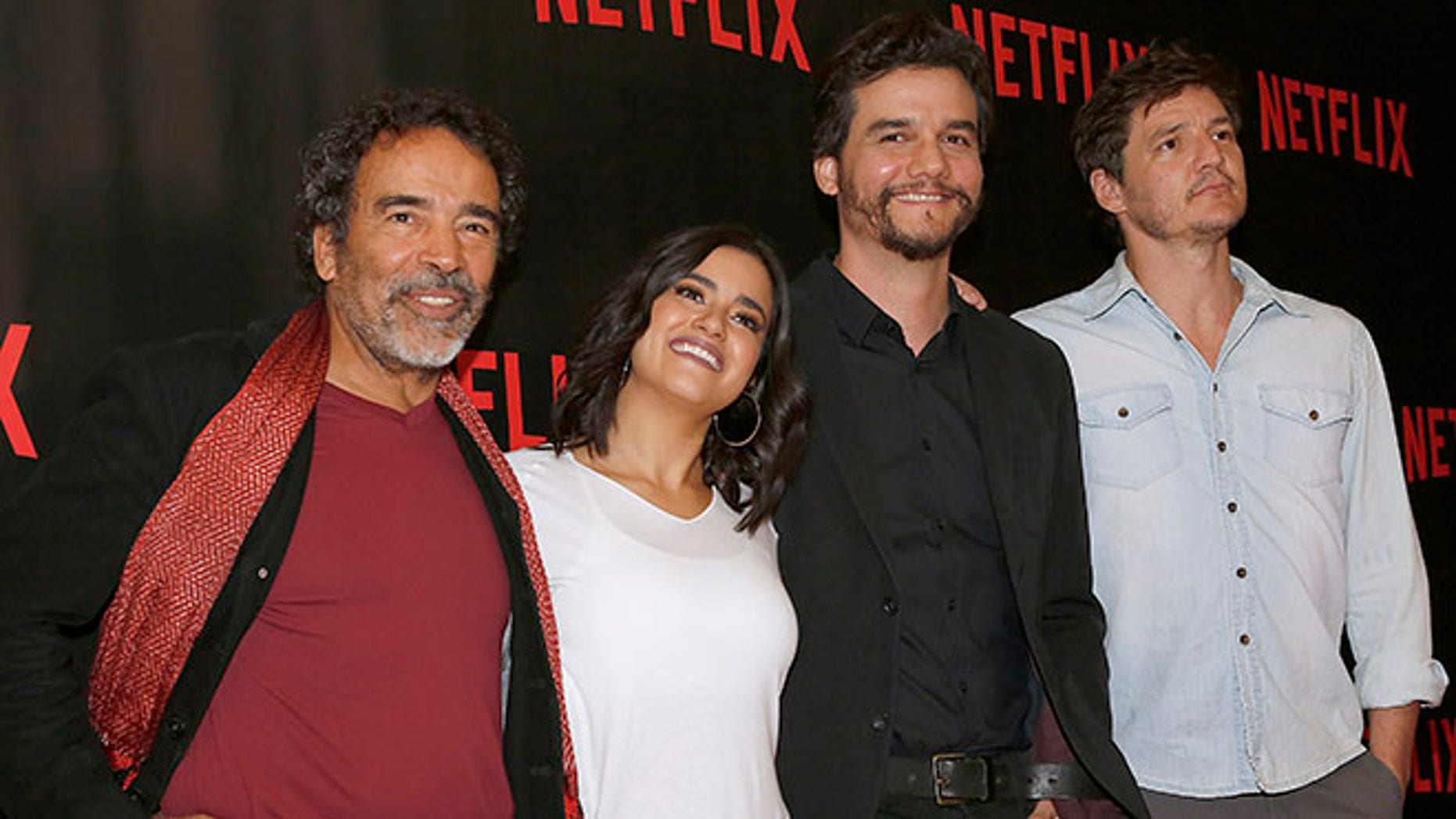 """Damian Alcazar, from left to right, who plays the role of a Cali druglord named Gilberto Orejuela in the Netflix series """"Narcos"""", Paulina Gaitan, who plays the character of Pablo Escobar's wife Tata, Wagner Moura, who plays the role of Pablo Escobar, and, Pedro Pascal, who plays the role of a DEA agent named Javier Peña, pose for photos during a media call to promote their second season, in Mexico City, Tuesday, Aug. 16, 2016. """"Narcos"""" the Netflix series about the history of the cocaine route presents the downfall of Pablo Escobar in its second season premiering worldwide on Sept.2. (AP Photo/Marco Ugarte)"""