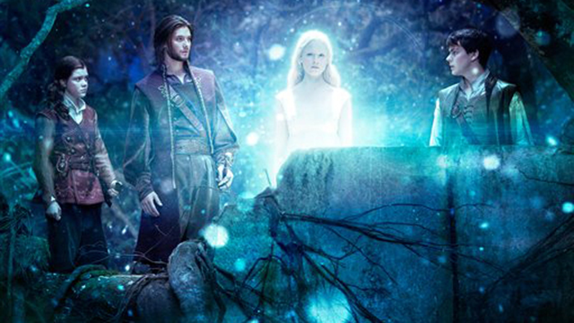 In this film publicity image released by 20th Century Fox, from left, Georgie Henley, Ben Barnes, Laura Brent, and Skandar Keynes are shown in a scene from The Chronicles of Narnia: The Voyage of the Dawn Treader.