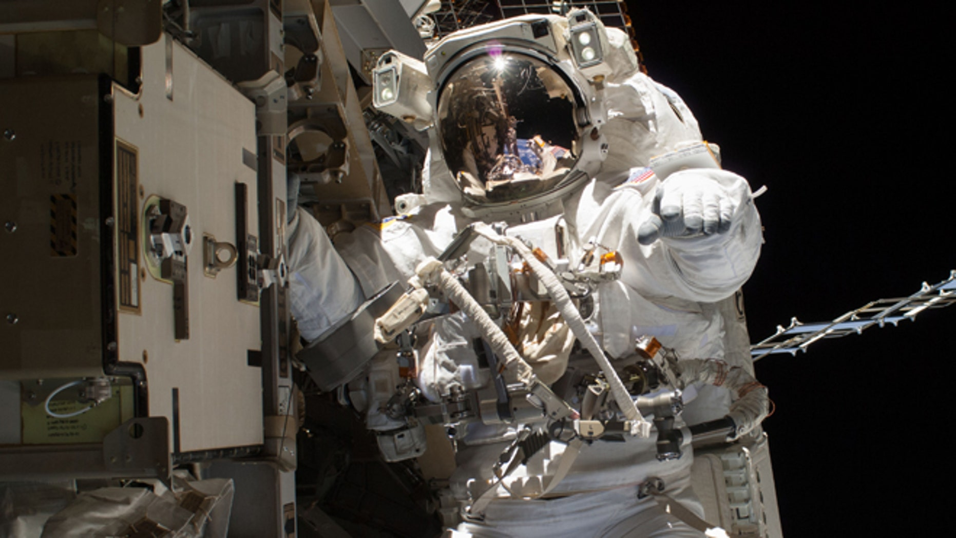 April 22, 2014: In this photo provided by NASA, astronaut Steve Swanson is pictured during a spacewalk to replace a failed backup computer relay box on the International Space Station.