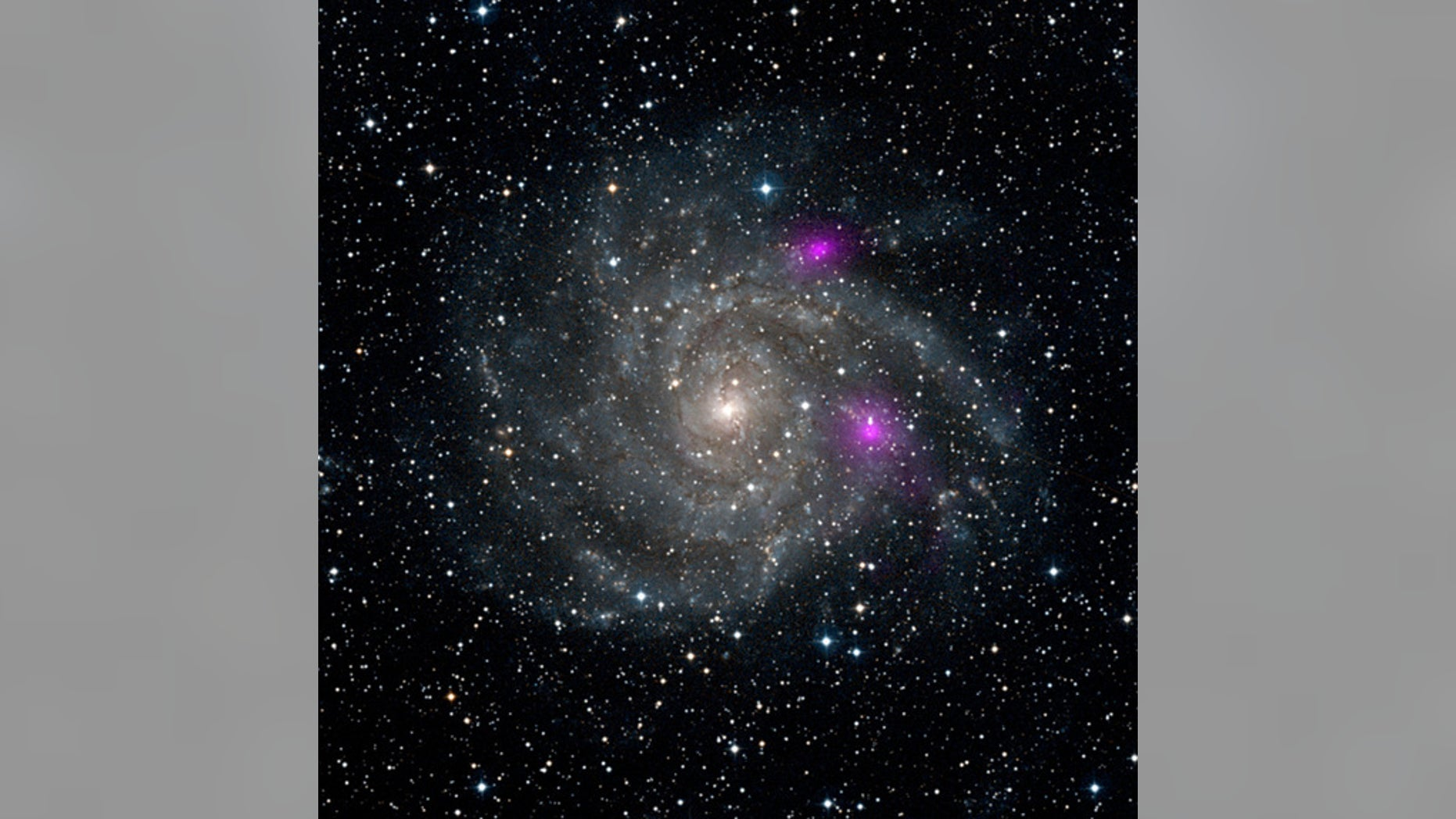 This new view of spiral galaxy IC 342, also known as Caldwell 5, includes data from NASA's Nuclear Spectroscopic Telescope Array, or NuSTAR. High-energy X-ray data from NuSTAR have been translated to the color magenta, and superimposed on a vis