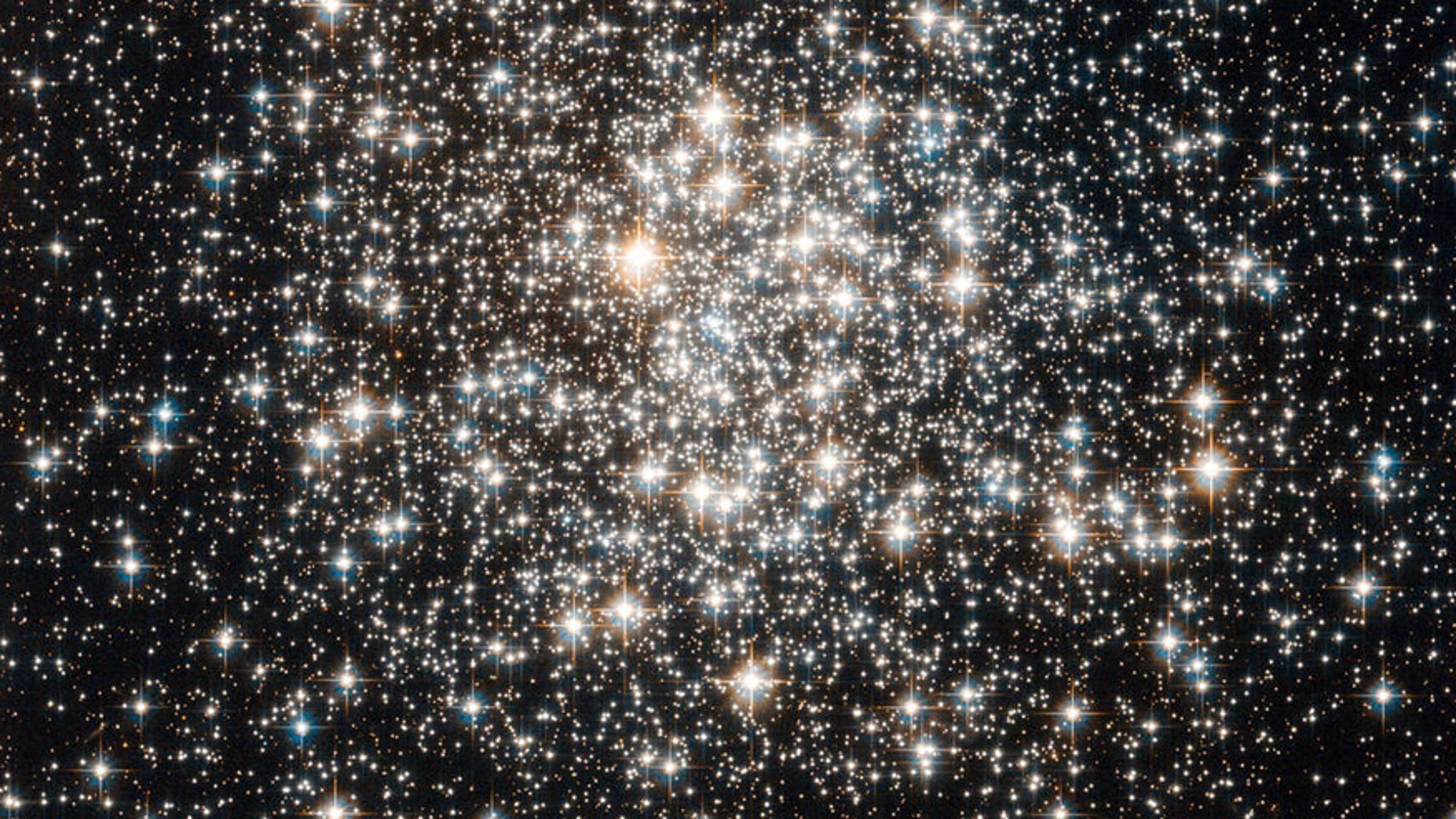 File photo - the Hubble Space Telescope has captured a crowd of stars that looks rather like a stadium darkened before a show, lit only by the flashbulbs of the audience's cameras. (NASA)