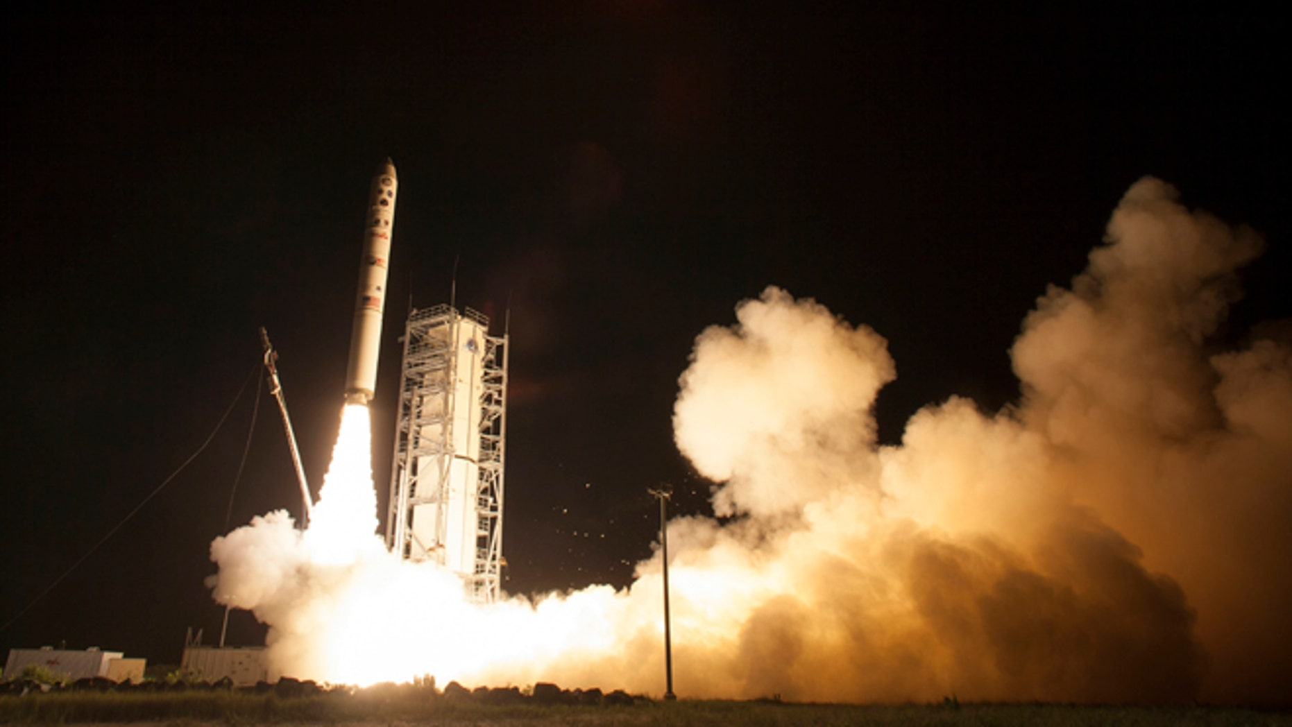Sept. 6, 2013: In this photo provided by NASA, an unmanned Minotaur rocket carries NASA's newest robotic explorer, the LADEE spacecraft, which is charged with studying the lunar atmosphere and dust, after launching to the moon from NASA's Wallops Flight Facility on Virginia's Eastern Shore.