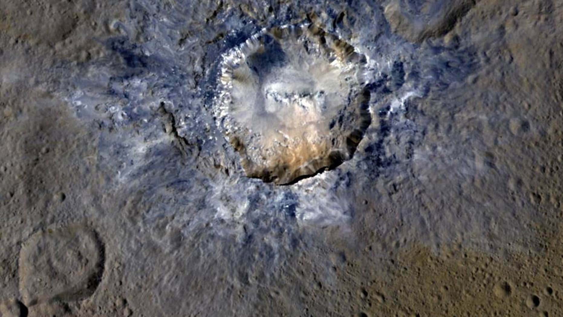 Ceres' Haulani Crater, with a diameter of 21 miles, shows evidence of landslides from its crater rim.  (Credits: NASA/JPL-Caltech/UCLA/MPS/DLR/IDA)