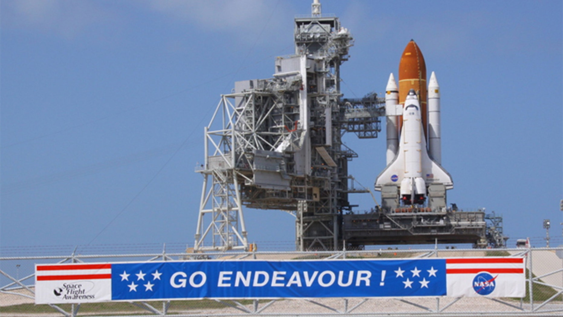NASA must now deal with scammers on top of a delayed shuttle launch.