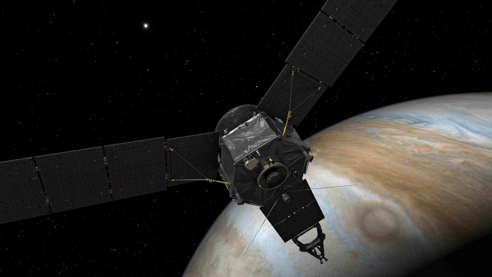 Artist's impression of NASA' s Juno spacecraft at Jupiter (NASA/JPL-Caltech)