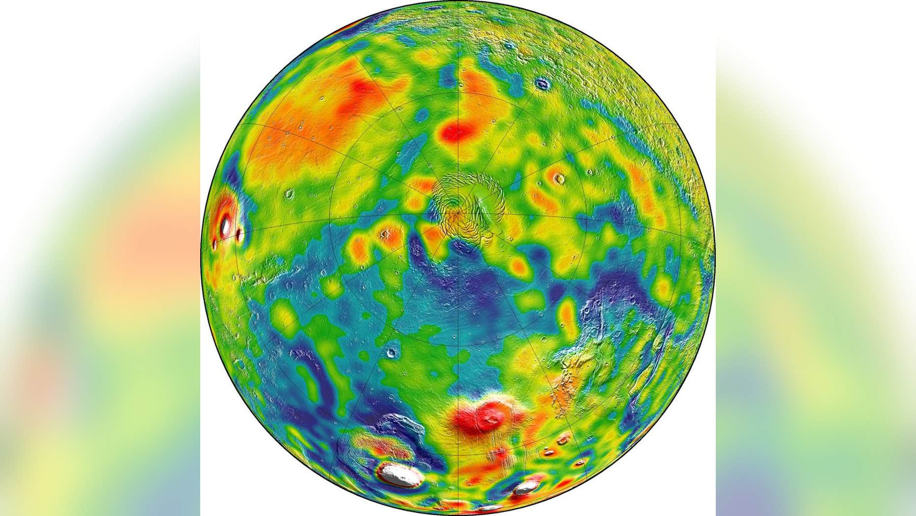A map of Martian gravity looking down on the North Pole (center). White and red are areas of higher gravity; blue indicates areas of lower gravity. (Credits: MIT/UMBC-CRESST/GSFC)