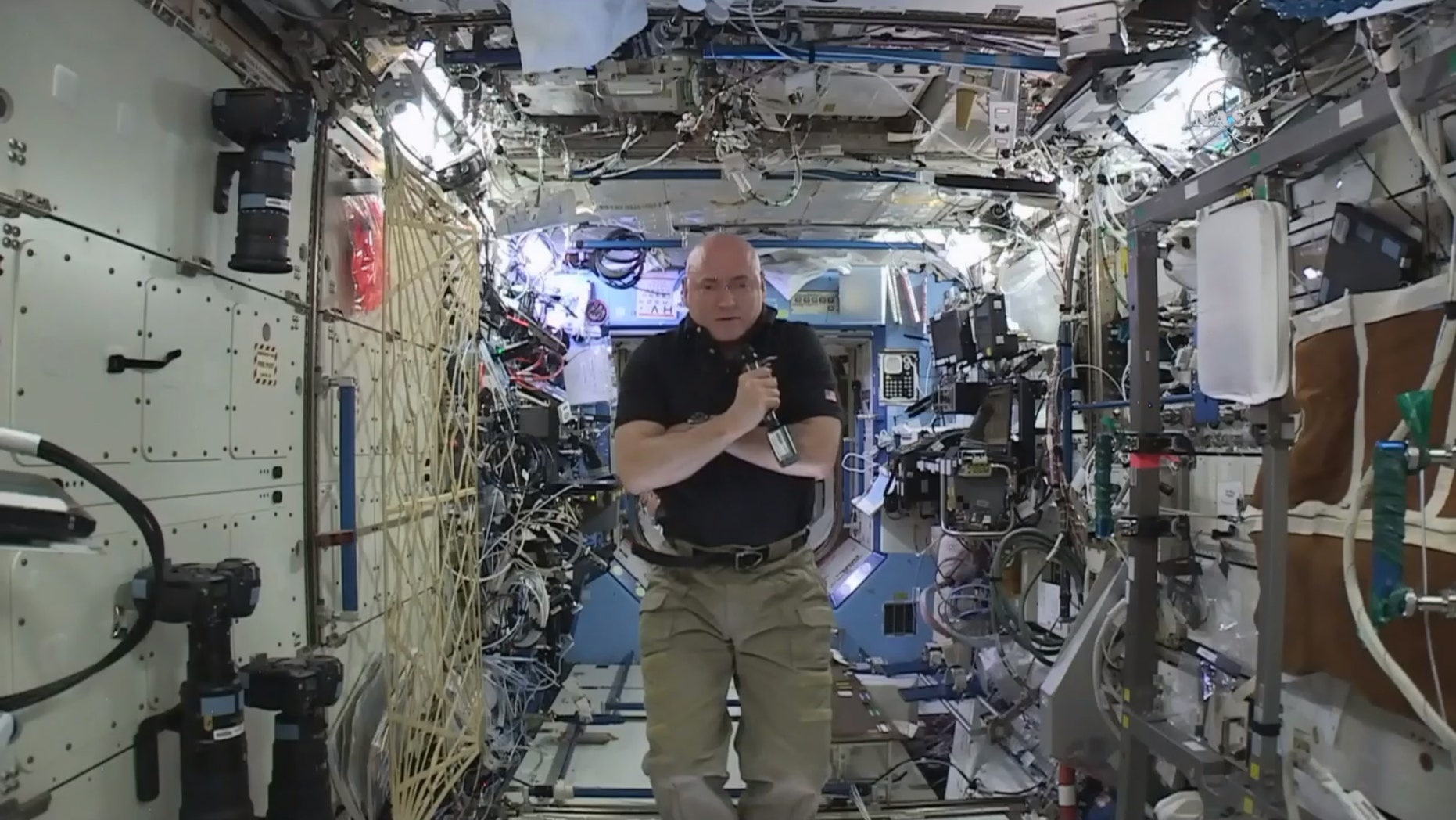 In this image from video made available by NASA, astronaut Scott Kelly speaks to reporters on Earth during a news conference held on the International Space Station on Thursday, Feb. 25, 2016. After nearly a year in space, Kelly is just a few days away from returning to Earth. He'll leave Tuesday on a Russian Soyuz capsule back to the planet to end NASA's longest space flight ever. (NASA via AP)