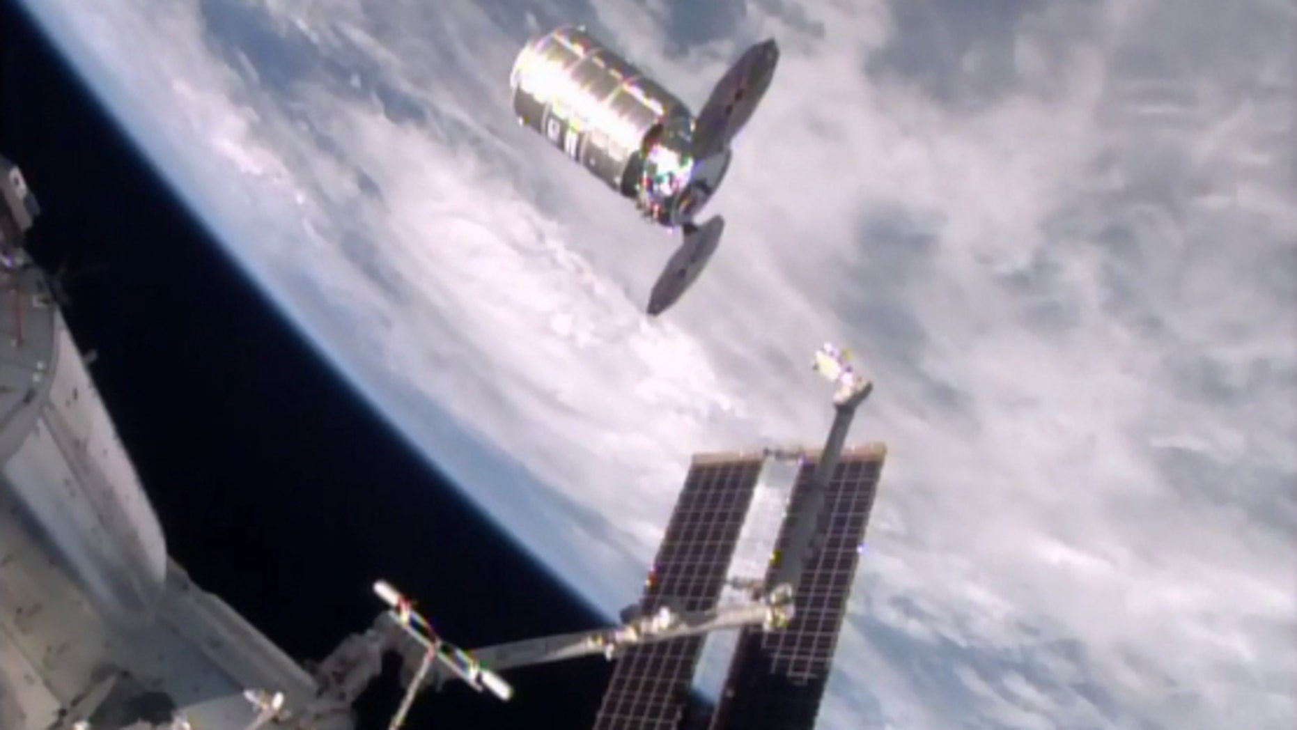 This photo taken from NASA TV shows a capsule loaded with 1.5 tons of trash, released from the International Space Station on Friday, Feb. 19, 2016.  NASA supplier Orbital ATK launched the capsule, named Cygnus, to the space station in December, full of food, clothes and other goods. Astronauts removed the precious contents, then filled it with garbage for incineration.  The spacecraft should re-enter the atmosphere and burn up harmlessly over the Pacific on Saturday.  (NASA via AP)