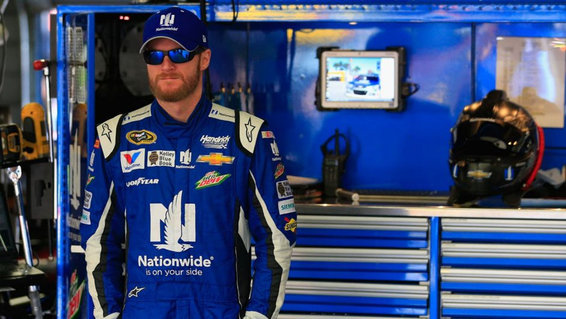 LOUDON, NH - SEPTEMBER 26: Dale Earnhardt Jr., driver of the #88 Nationwide Chevrolet, stands in the garage area during practice for the NASCAR Sprint Cup Series Sylvania 300 at New Hampshire Motor Speedway on September 26, 2015 in Loudon, New Hampshire. (Photo by Chris Trotman/Getty Images)