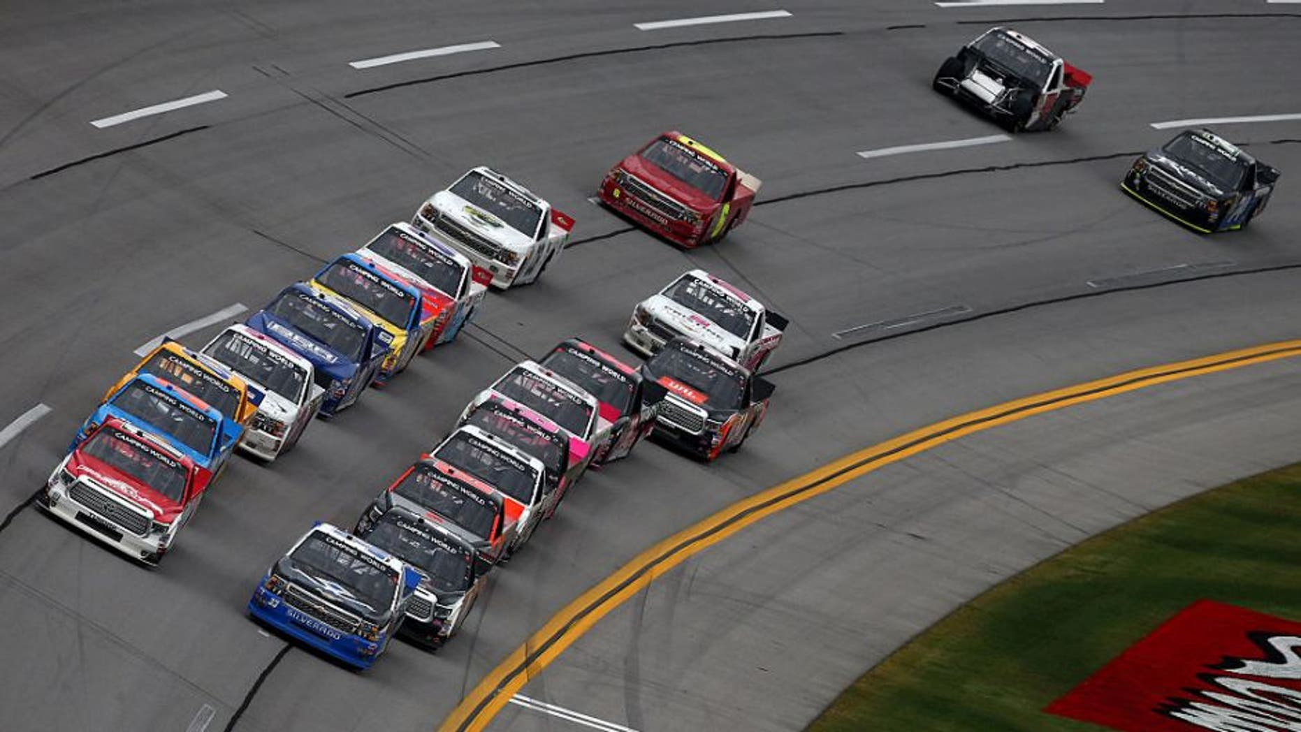 TALLADEGA, AL - OCTOBER 24: Timothy Peters, driver of the #17 Red Horse Racing Toyota, and Brandon Jones, driver of the #33 Wittichen Supply Company Chevrolet, lead the field to a restart during the NASCAR Camping World Truck Series fred's 250 at Talladega Superspeedway on October 24, 2015 in Talladega, Alabama. (Photo by Tom Pennington/Getty Images)