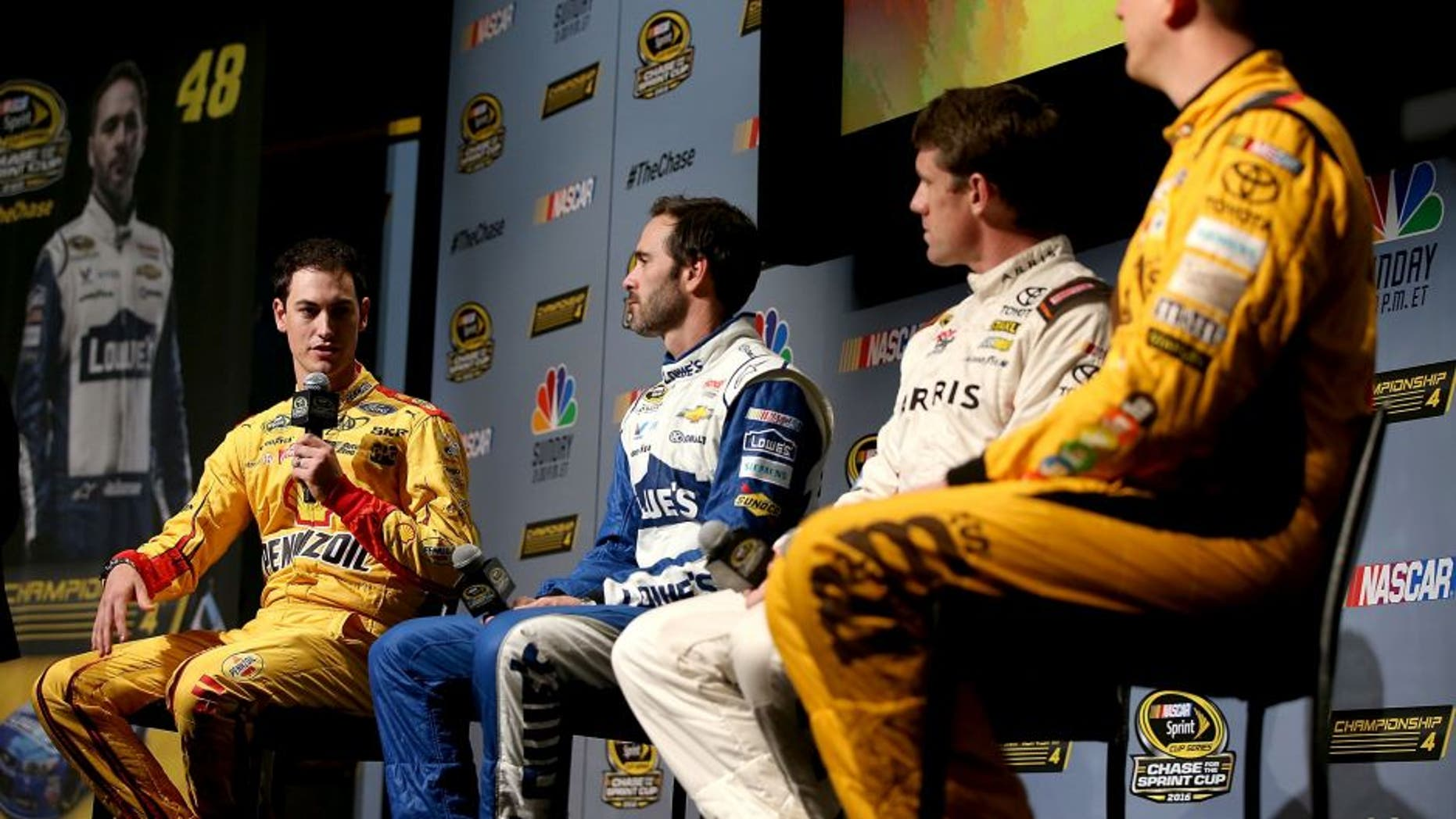 MIAMI BEACH, FL - NOVEMBER 17: (L-R) Joey Logano, driver of the #22 Shell Pennzoil Ford, Jimmie Johnson, driver of the #48 Lowes Chevrolet, Carl Edwards, driver of the #19 Arris Surfboard Toyota, and Kyle Busch, driver of the (18) M&M's Core Toyota, talk to the media during media day for the NASCAR Sprint Cup Series Championship at the Loews Hotel on November 17, 2016 in Miami Beach, Florida. (Photo by Sean Gardner/NASCAR via Getty Images)