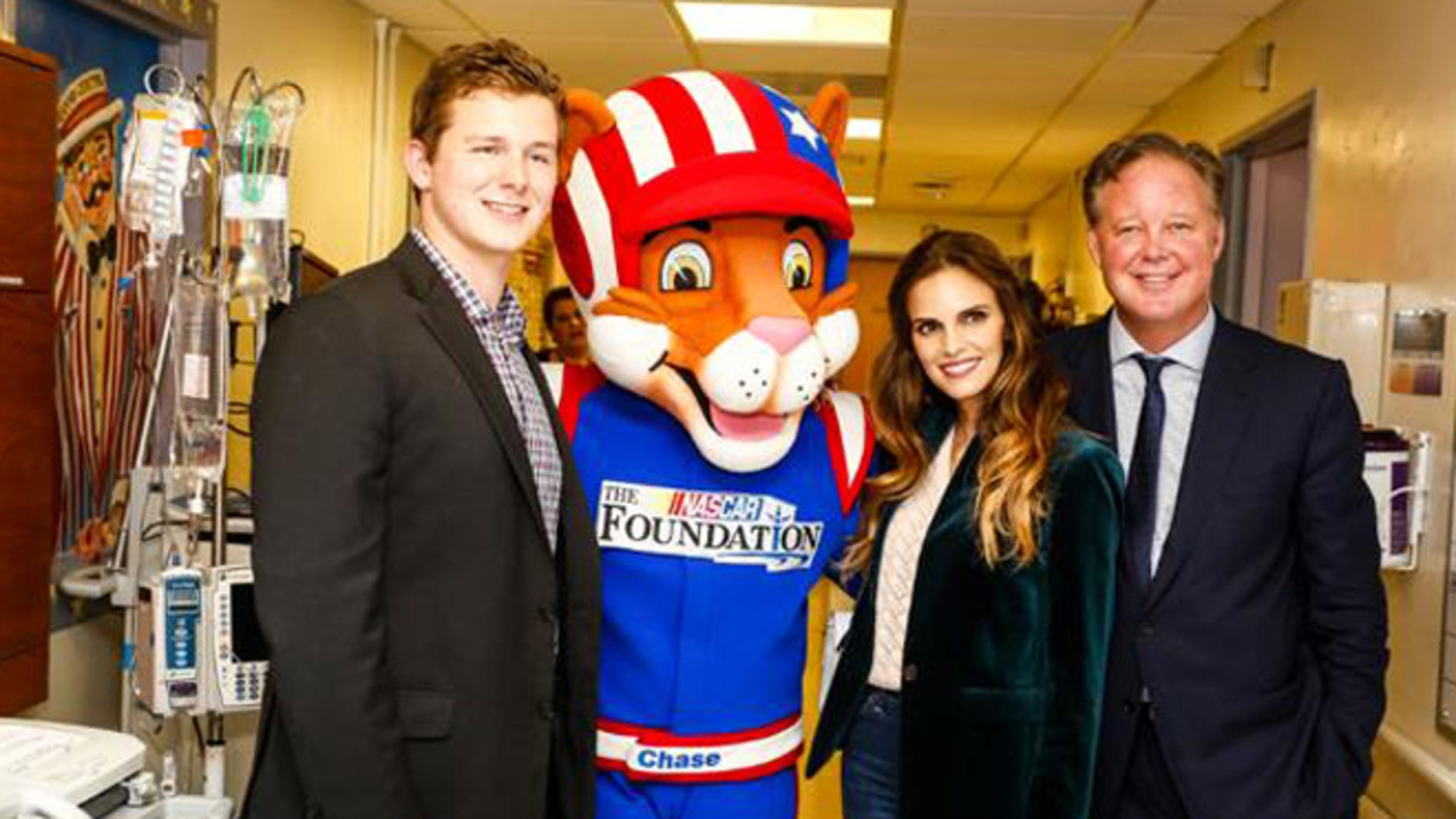 NASCAR Chairman and CEO Brian France (r), his wife Amy and NASCAR XFINITY Series Driver Matt Tifft (l) visited young patients at NYU Langone's Hassenfeld Children's Hospital Wednesday as part of the sport's Speediatrics Children's Fund.