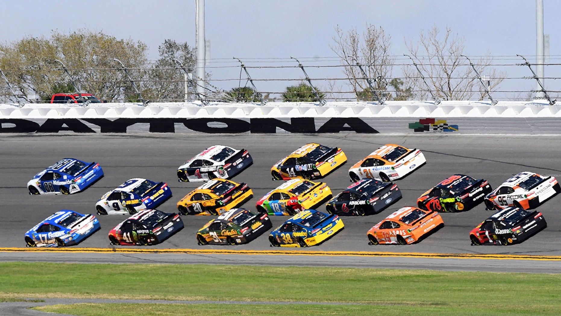 Feb 18, 2018; Daytona Beach, FL, USA; NASCAR Cup Series driver Alex Bowman (88) and Ricky Stenhouse Jr. (17)  lead the field during the Daytona 500 at Daytona International Speedway. Mandatory Credit: Mike DiNovo-USA TODAY Sports - 10627874
