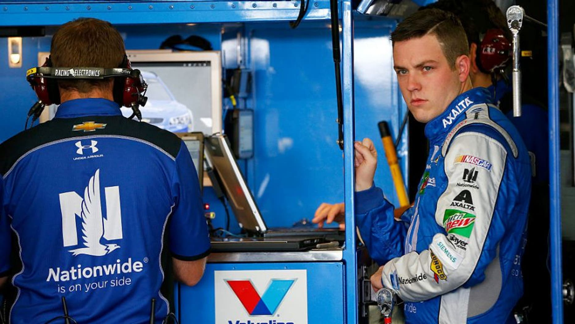 LOUDON, NH - SEPTEMBER 23: Alex Bowman, driver of the #88 Nationwide Chevrolet, stands in the garage area during practice for the NASCAR Sprint Cup Series Bad Boy Off Road 300 at New Hampshire Motor Speedway on September 23, 2016 in Loudon, New Hampshire. (Photo by Jonathan Ferrey/Getty Images)