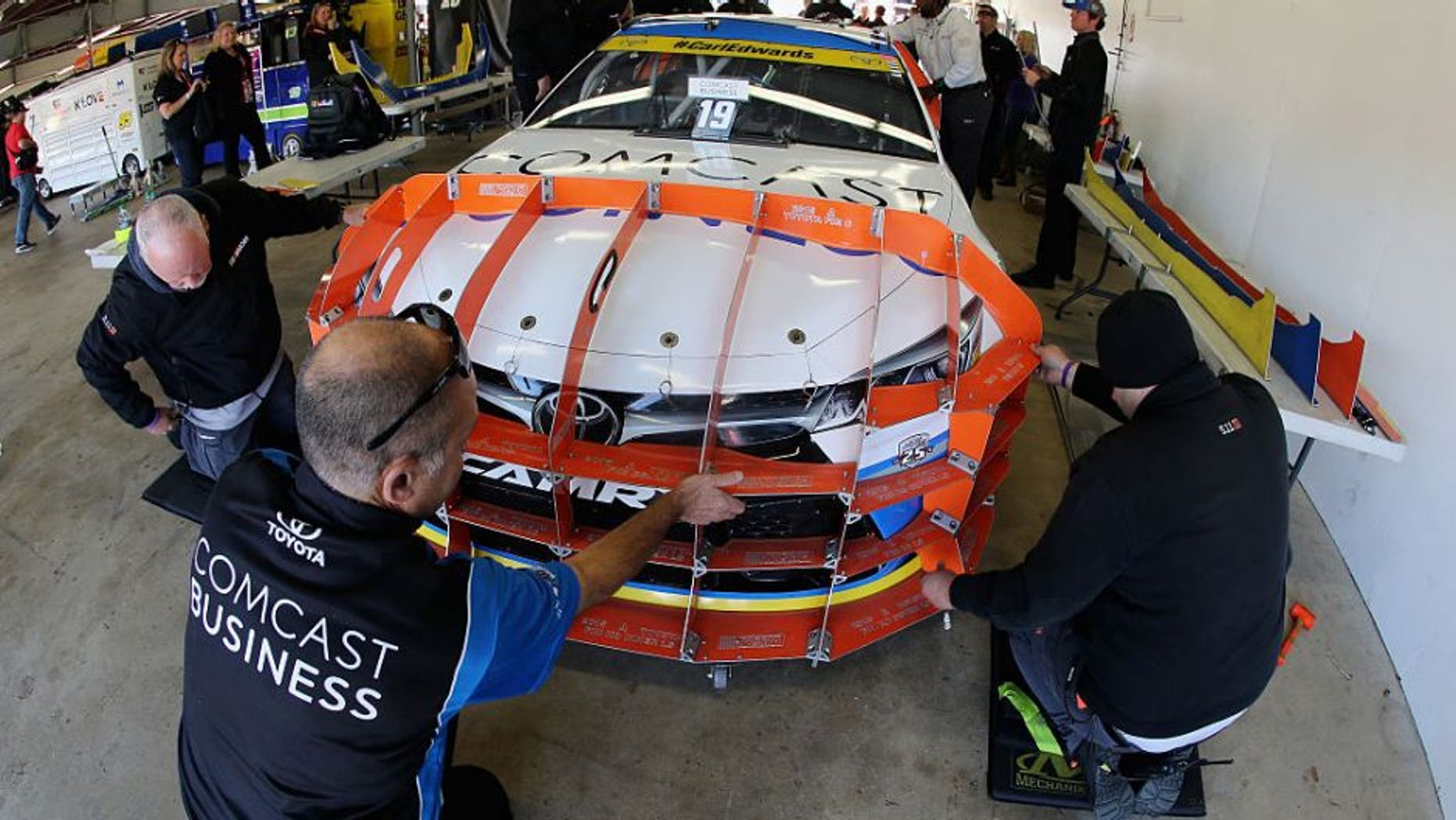 LOUDON, NH - SEPTEMBER 25: The car of Carl Edwards, driver of the #19 Comcast Business Toyota, goes through pre-race inspection prior to the NASCAR Sprint Cup Series Bad Boy Off Road 300 at New Hampshire Motor Speedway on September 25, 2016 in Loudon, New Hampshire. (Photo by Jerry Markland/Getty Images)