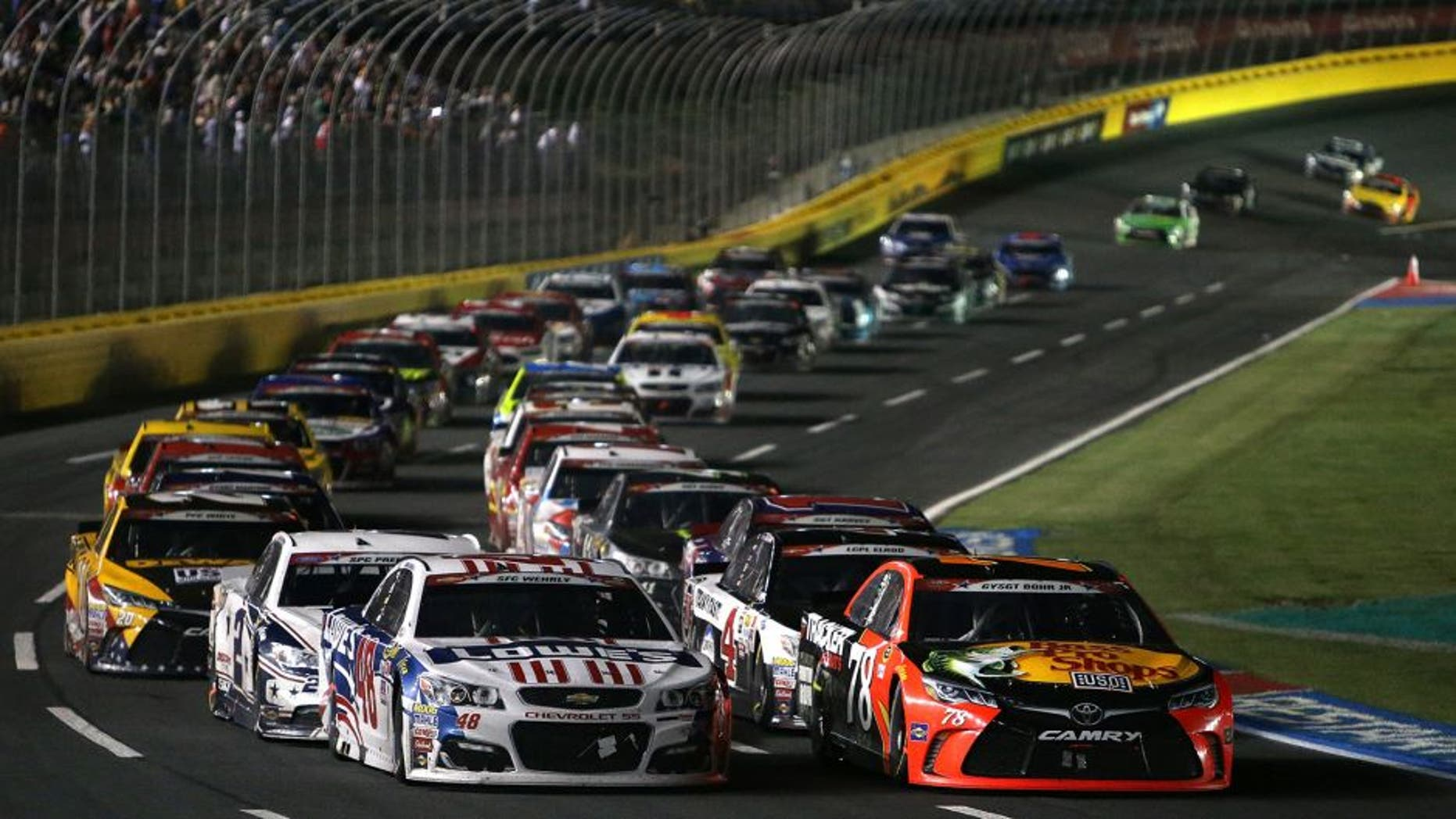 CHARLOTTE, NC - MAY 29: Martin Truex Jr., driver of the #78 Bass Pro Shops/Tracker Toyota, and Jimmie Johnson, driver of the #48 Lowe's Patriotic Chevrolet, lead a restart during the NASCAR Sprint Cup Series Coca-Cola 600 at Charlotte Motor Speedway on May 29, 2016 in Charlotte, North Carolina. (Photo by Jerry Markland/NASCAR via Getty Images)