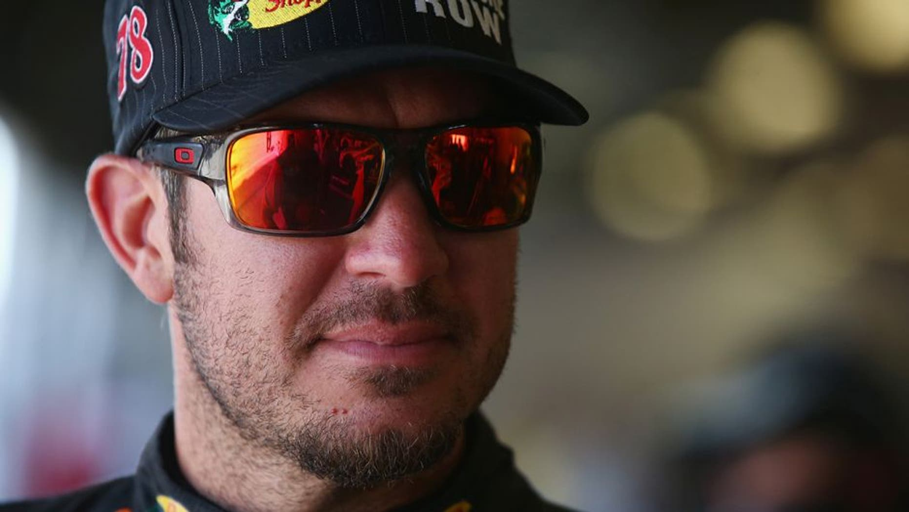DAYTONA BEACH, FL - JULY 01: Martin Truex Jr., driver of the #78 Bass Pro Shops/Tracker Boats Toyota, stands in the garage area during practice for the NASCAR Sprint Cup Series Coke Zero 400 at Daytona International Speedway on July 1, 2016 in Daytona Beach, Florida. (Photo by Sarah Crabill/NASCAR via Getty Images)