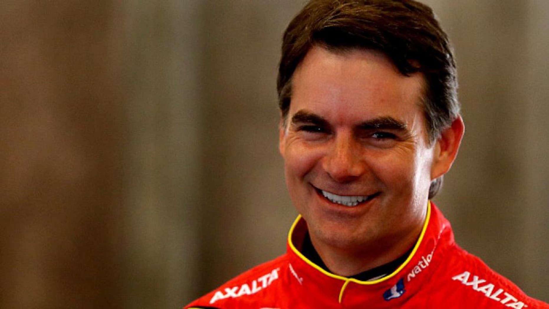 INDIANAPOLIS, IN - JULY 22: Jeff Gordon, driver of the #88 Axalta Chevrolet, stands in the garage area during practice for the NASCAR Sprint Cup Series Crown Royal presents the Combat Wounded Coalition 400 at the Brickyard at Indianapolis Motor Speedway on July 23, 2016 in Indianapolis, Indiana. (Photo by Sean Gardner/NASCAR via Getty Images)