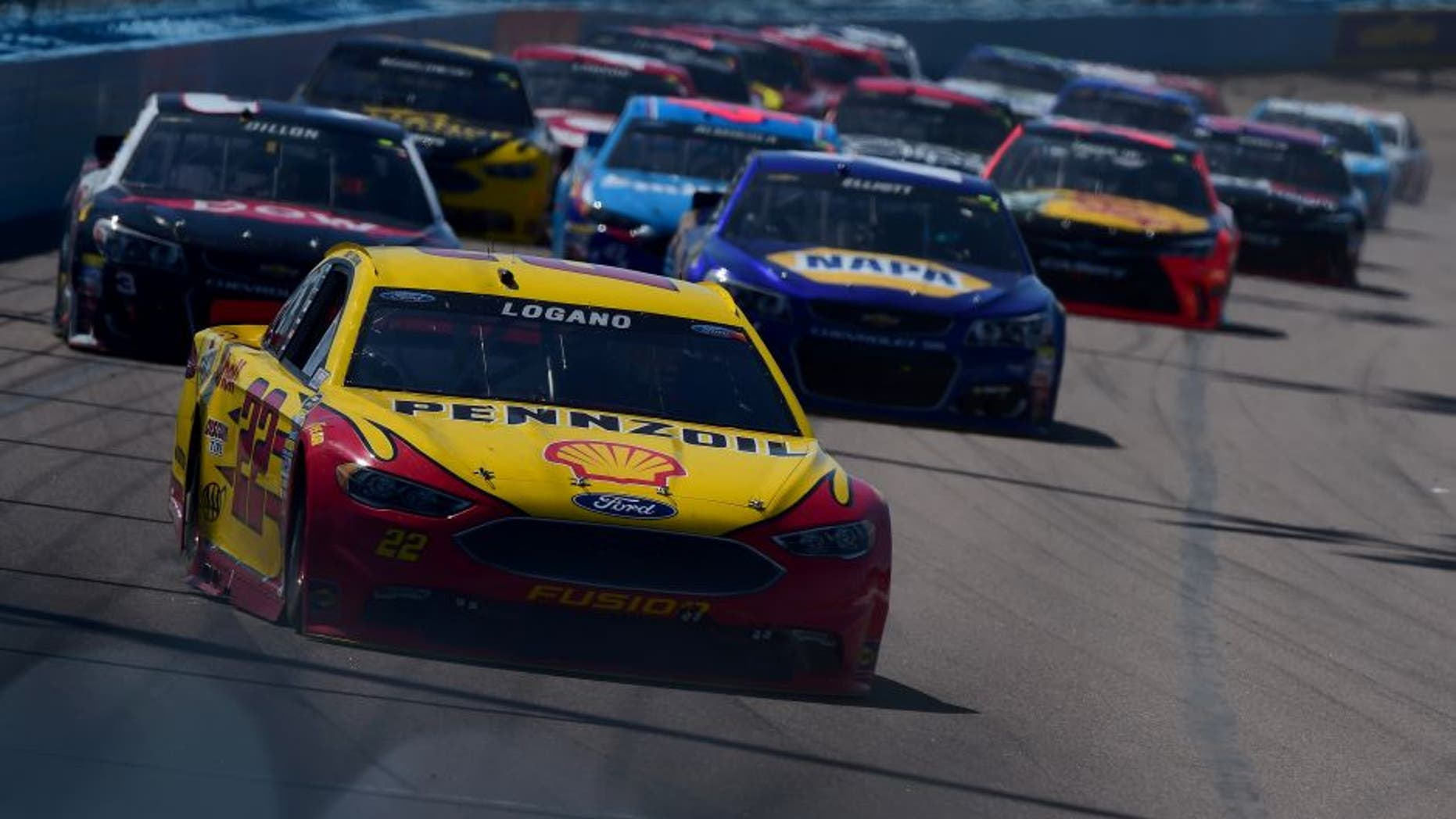 AVONDALE, AZ - MARCH 13: Joey Logano, driver of the #22 Pennzoil Ford, leads a pack of cars during the NASCAR Sprint Cup Series Good Sam 500 at Phoenix International Raceway on March 13, 2016 in Avondale, Arizona. (Photo by Jared C. Tilton/Getty Images)