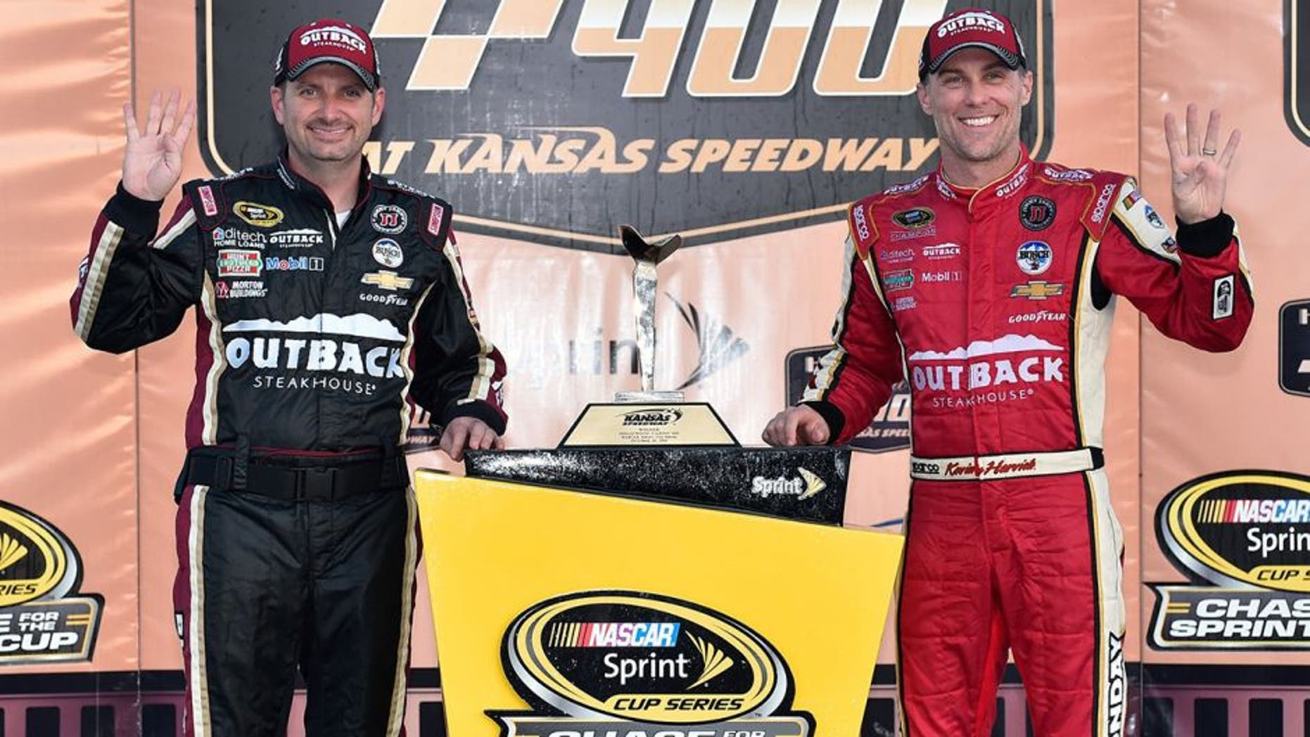KANSAS CITY, KS - OCTOBER 16: Kevin Harvick, driver of the #4 Outback Chevrolet, and crew chief Rodney Childers pose with the trophy after winning the NASCAR Sprint Cup Series Hollywood Casino 400 at Kansas Speedway on October 16, 2016 in Kansas City, Kansas. (Photo by Jason Hanna/Getty Images)