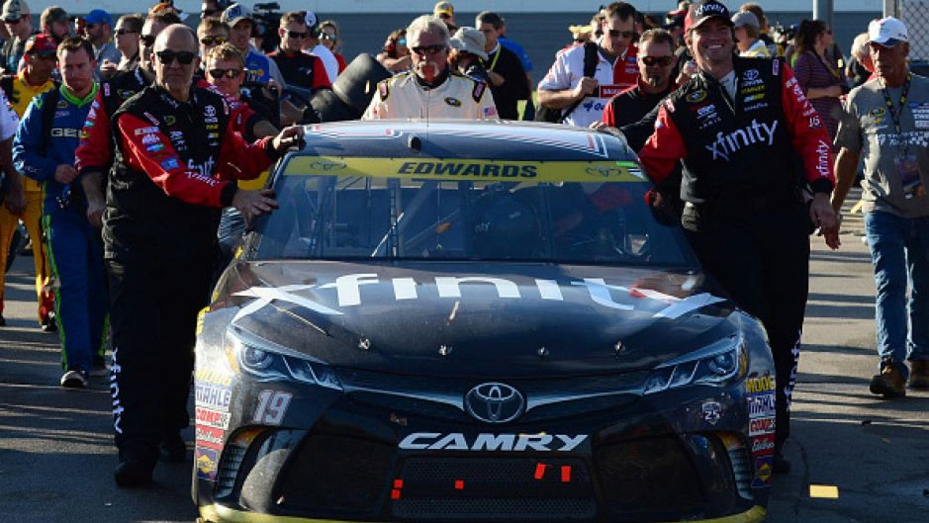 KANSAS CITY, KS - OCTOBER 16: Crew members push the #19 Xfinity Toyota through the garage area after the NASCAR Sprint Cup Series Hollywood Casino 400 at Kansas Speedway on October 16, 2016 in Kansas City, Kansas. (Photo by Jeff Curry/Getty Images)