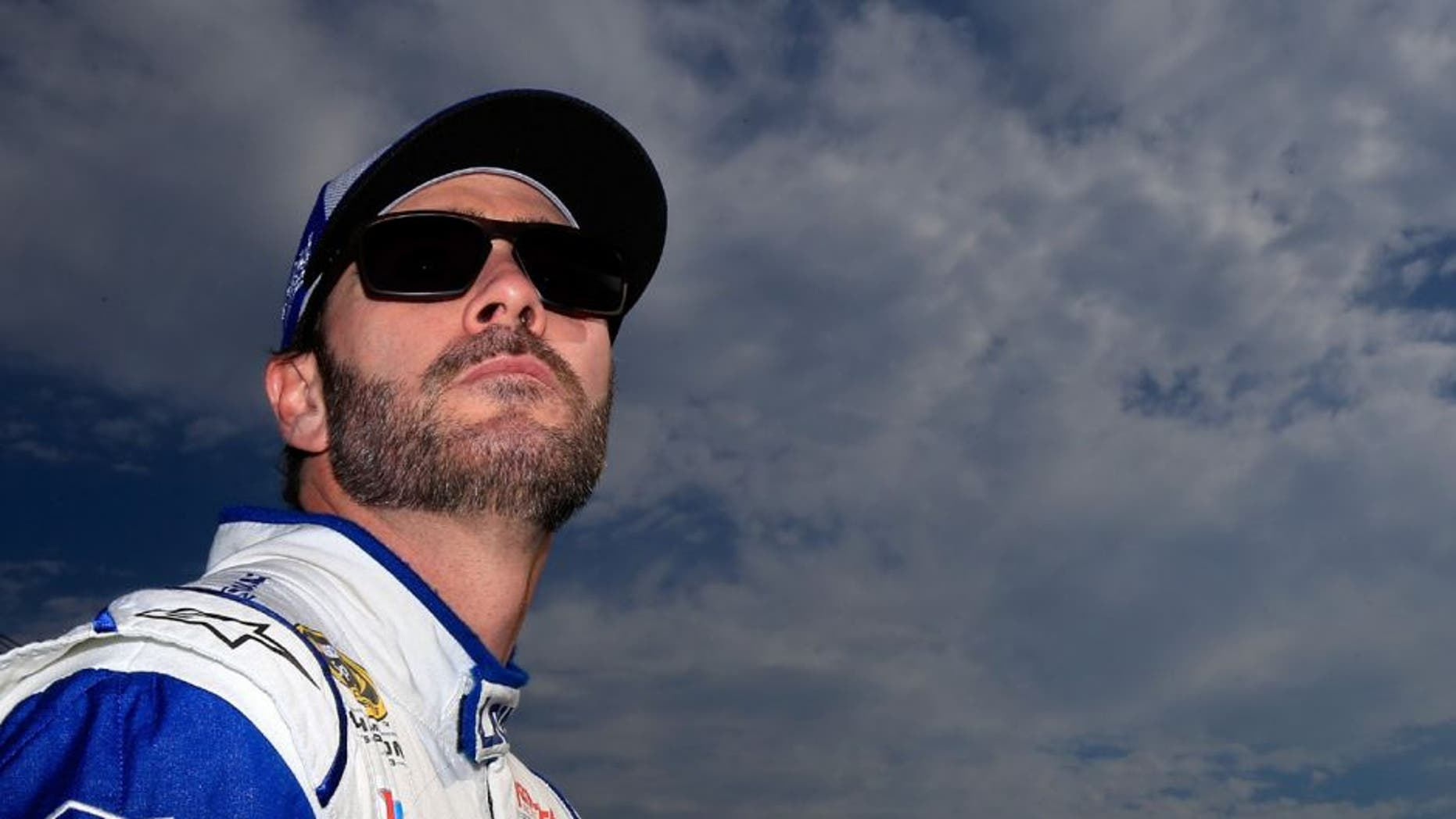 LOUDON, NH - JULY 15: Jimmie Johnson, driver of the #48 Lowe's Chevrolet, stands on the grid during qualifying for the NASCAR Sprint Cup Series New Hampshire 301 at New Hampshire Motor Speedway on July 16, 2016 in Loudon, New Hampshire. (Photo by Chris Trotman/Getty Images)