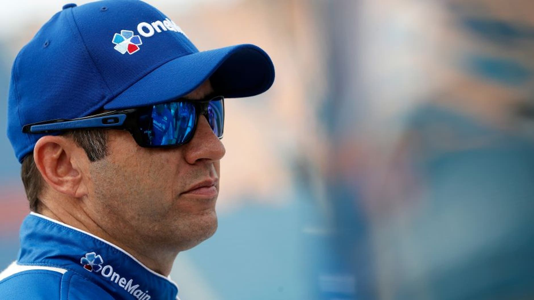 JOLIET, IL - SEPTEMBER 17: Elliott Sadler, driver of the #1 OneMain Chevrolet, stands on the grid during qualifying for the NASCAR XFINITY Series Drive for Safety 300 at Chicagoland Speedway on September 17, 2016 in Joliet, Illinois. (Photo by Brian Lawdermilk/NASCAR via Getty Images)