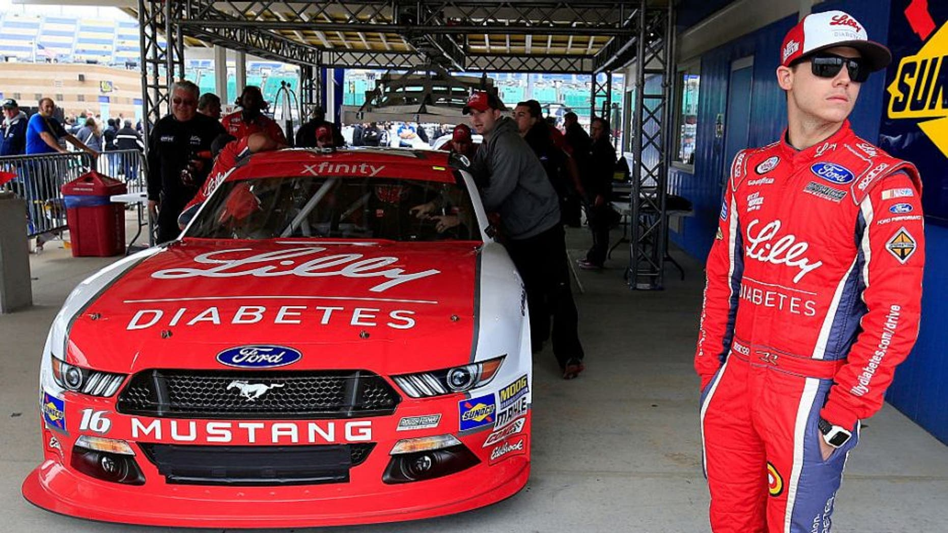 KANSAS CITY, KS - OCTOBER 15: Ryan Reed, driver of the #16 Lilly Diabetes/American Diabetes Association Ford, waits as his car is inspected by NASCAR officials prior to qualifying for the NASCAR XFINITY Series Kansas Lottery 300 at Kansas Speedway on October 15, 2016 in Kansas City, Kansas. (Photo by Chris Trotman/Getty Images)