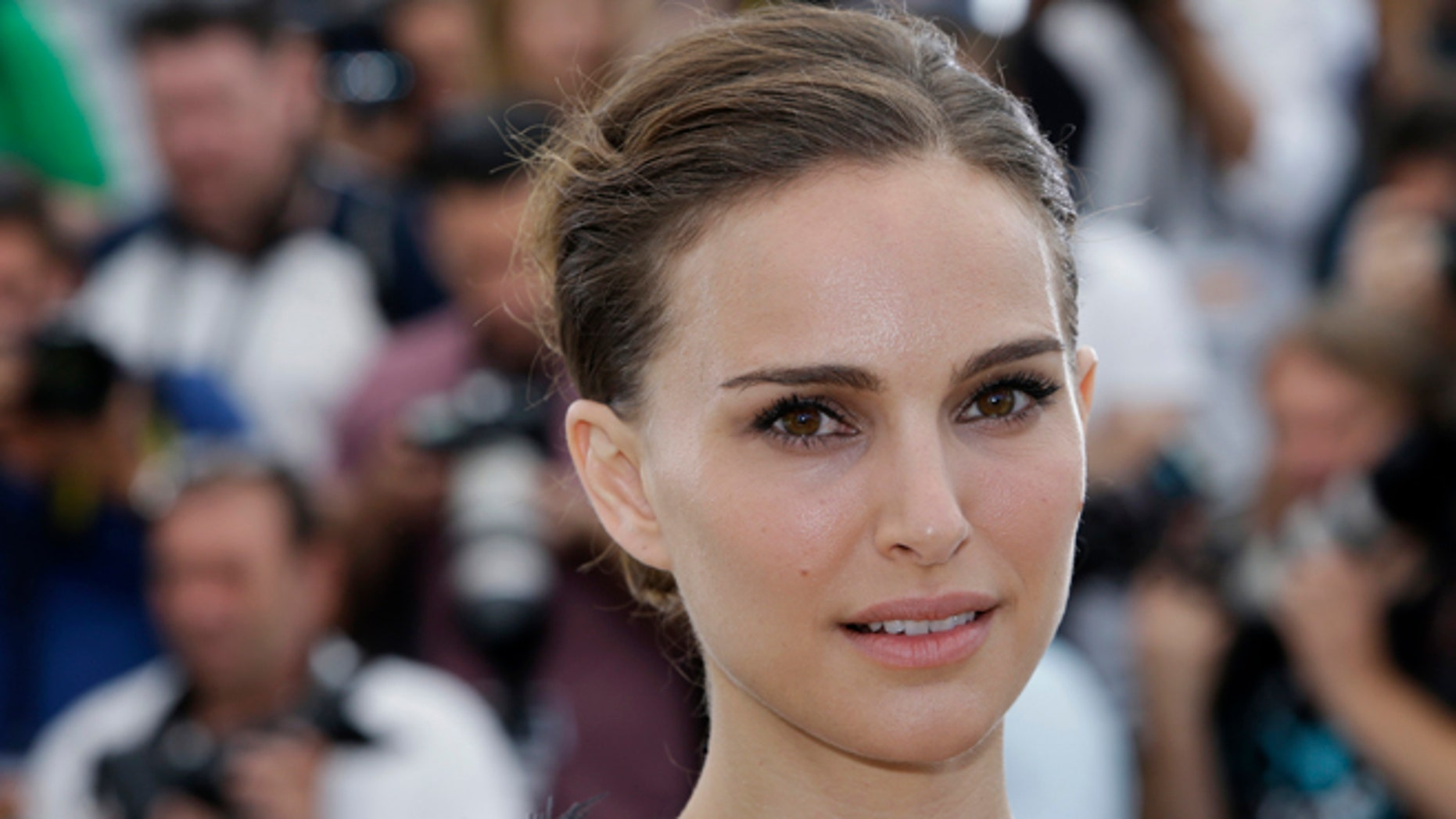 """May 17, 2015 file photo, Natalie Portman poses for photographers during a photo call for the film """"A Tale of Love and Darkness,"""" at the 68th international film festival, Cannes, southern France."""