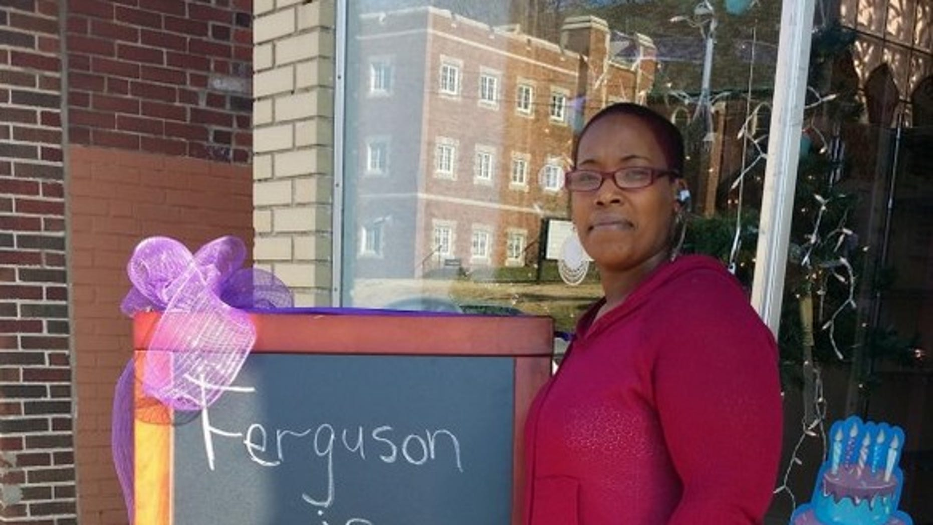 Natalie DuBose is pictured outside of her bakery in Ferguson, Mo.