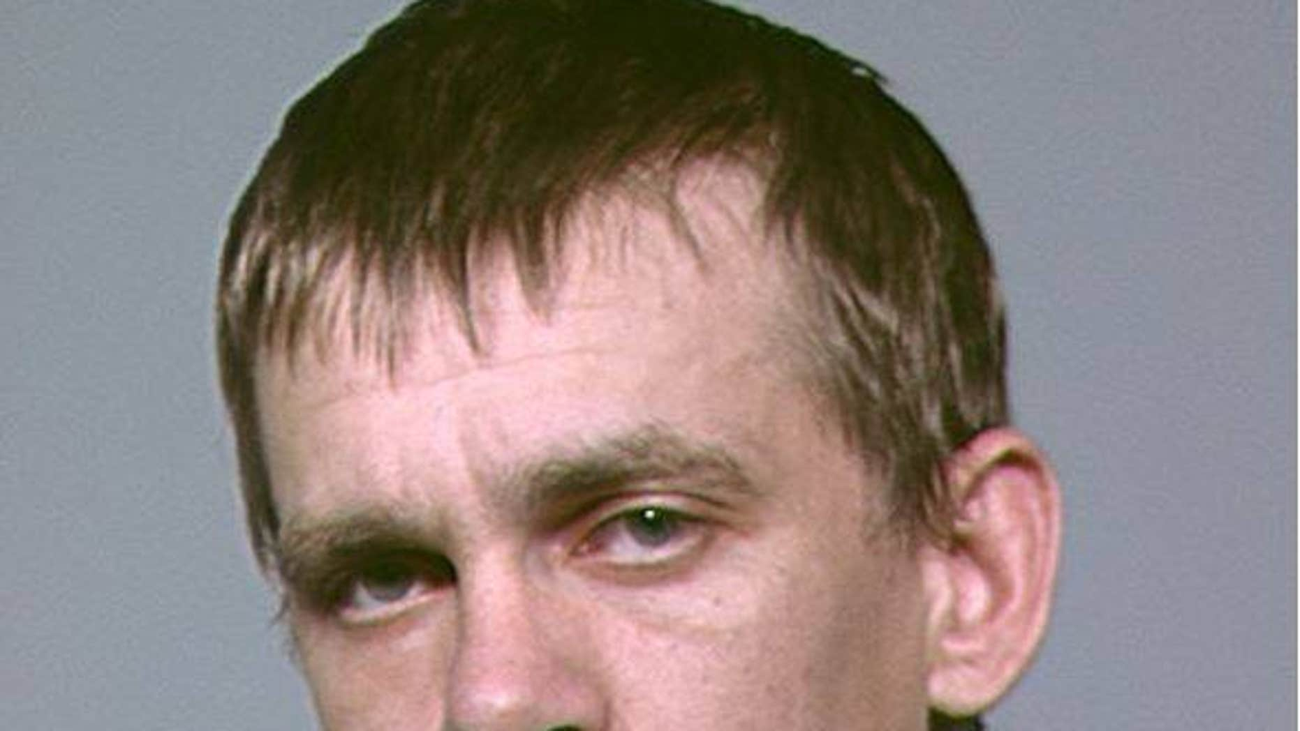 Nathan Alexander Wilson, 34, is suspected of killing his parents at their home on Monday morning.