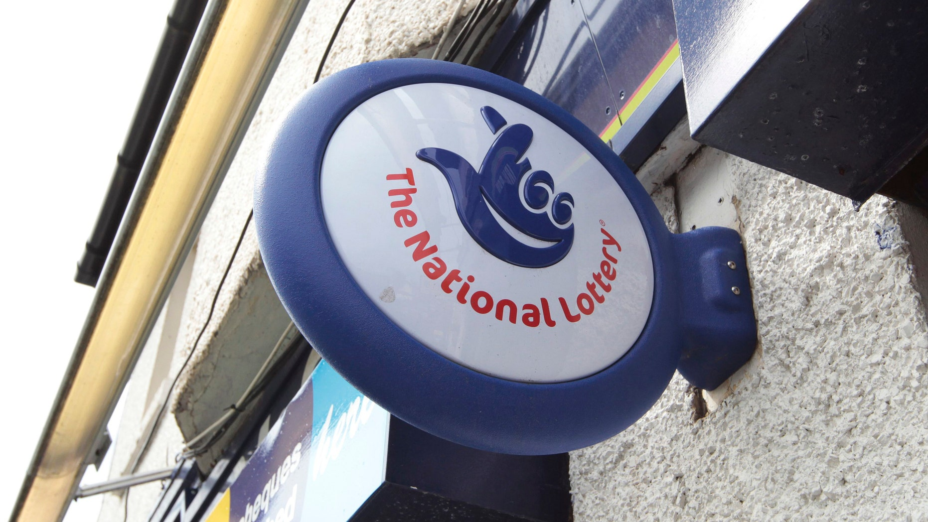 File photo - A National Lottery sign is seen over the entrance of a newsagents (REUTERS/David Moir).