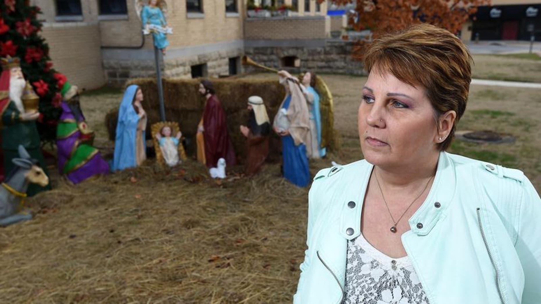 Dessa Blackthorn next to the Nativity scene in 2014.