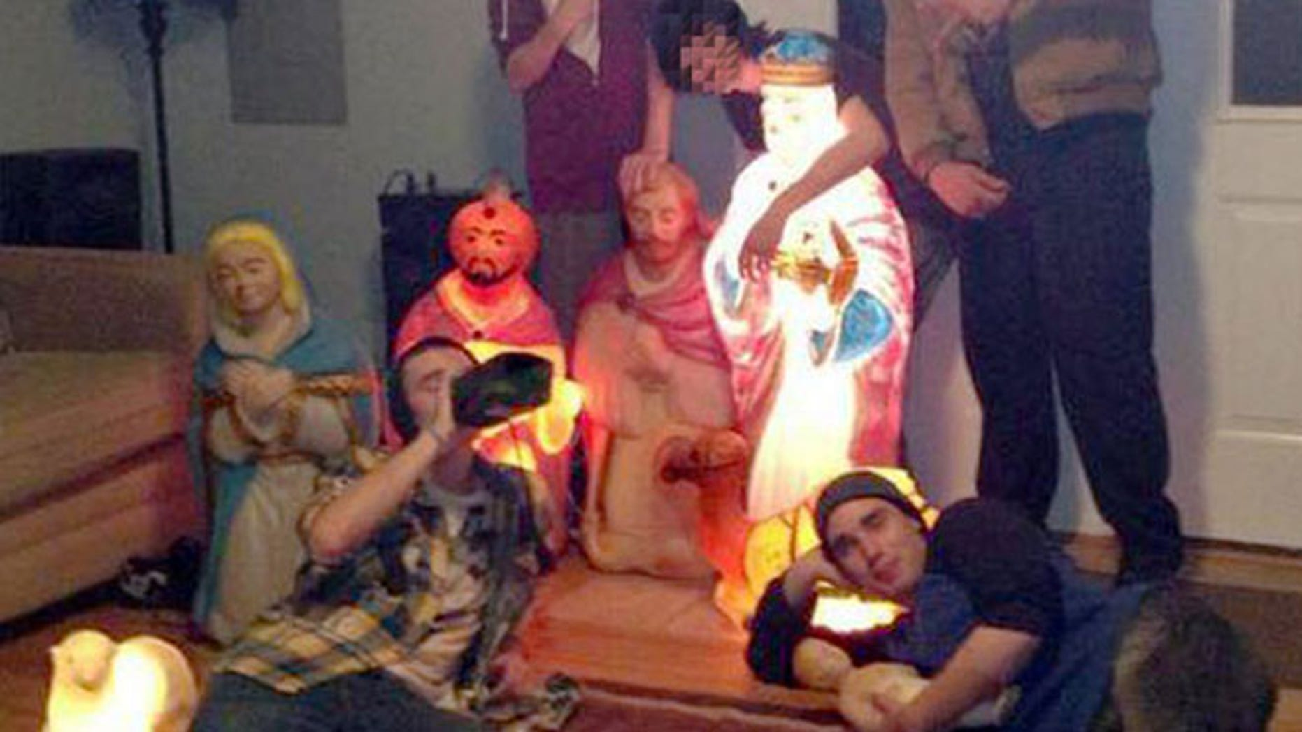 This undated photo shows the nativity scene and the teens charged with stealing it.