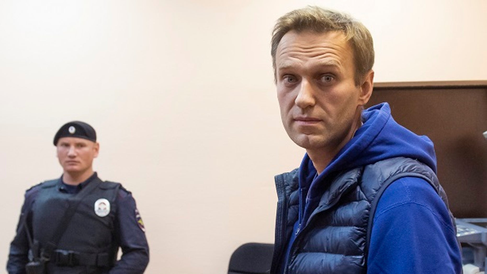Russian opposition activist Alexei Navalny stands in a court room as he waits for a session in Moscow, Russia, Monday, Sept. 24, 2018. Navalny was released from jail on Monday at the end of a 30-day sentence for staging an unsanctioned protest — and then immediately detained again on staging another past protest. (AP Photo/Dmitry Serebryakov)