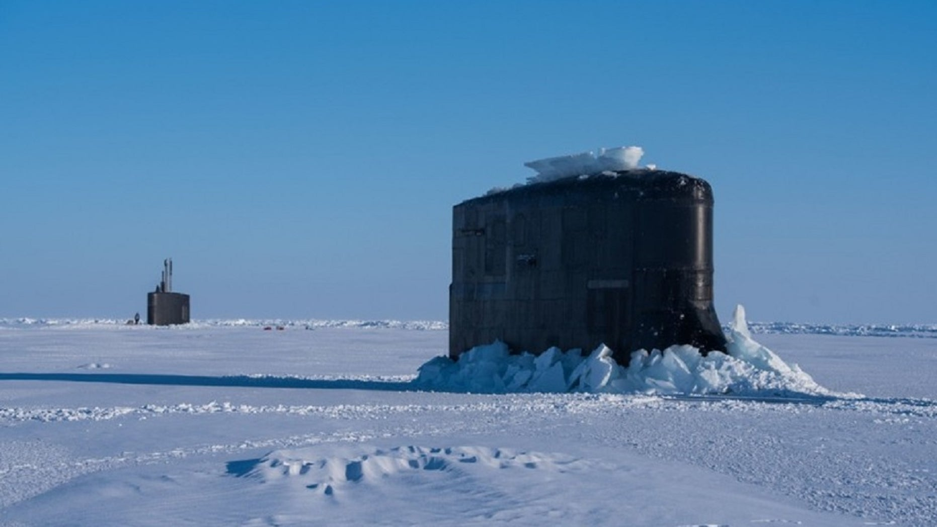 The submarine USS Connecticut and fast-attack submarine USS Hartford breakthrough the ice in support of Ice Exercise 2018 near Ice Camp Skate in the Arctic Circle, March 10, 2018.