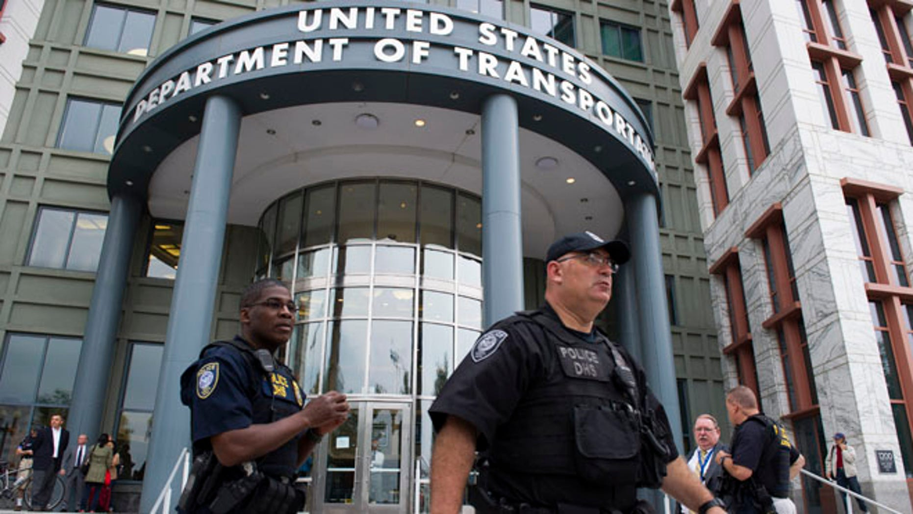 July 2, 2015: Police outside the Transportation Department, inside the  Washington Navy Yard, after reports of shots fired. Washington, D.C.